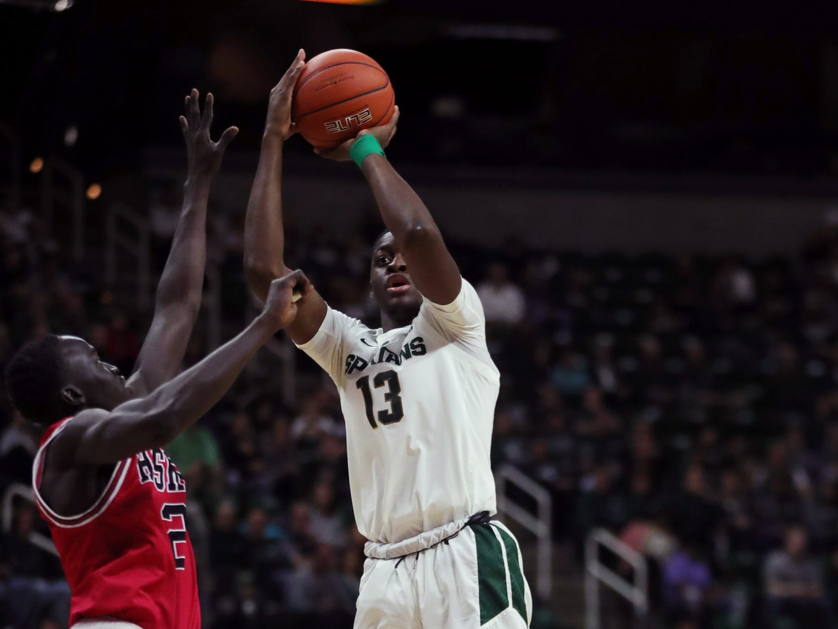 Michigan State forward Gabe Brown scores against Northern Illinois guard Gairges Daow during the second half Saturday, Dec. 29, 2018 at the Breslin Center in East Lansing.