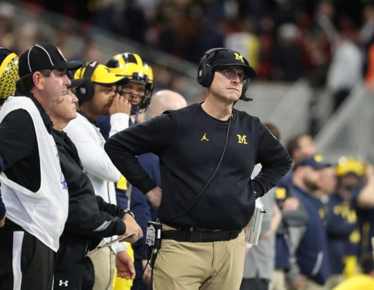 Michigan Wolverines head coach Jim Harbaugh reacts in the fourth quarter during the 41-15 loss to the Florida Gators in the Peach Bowl in Atlanta, Dec. 29, 2018.