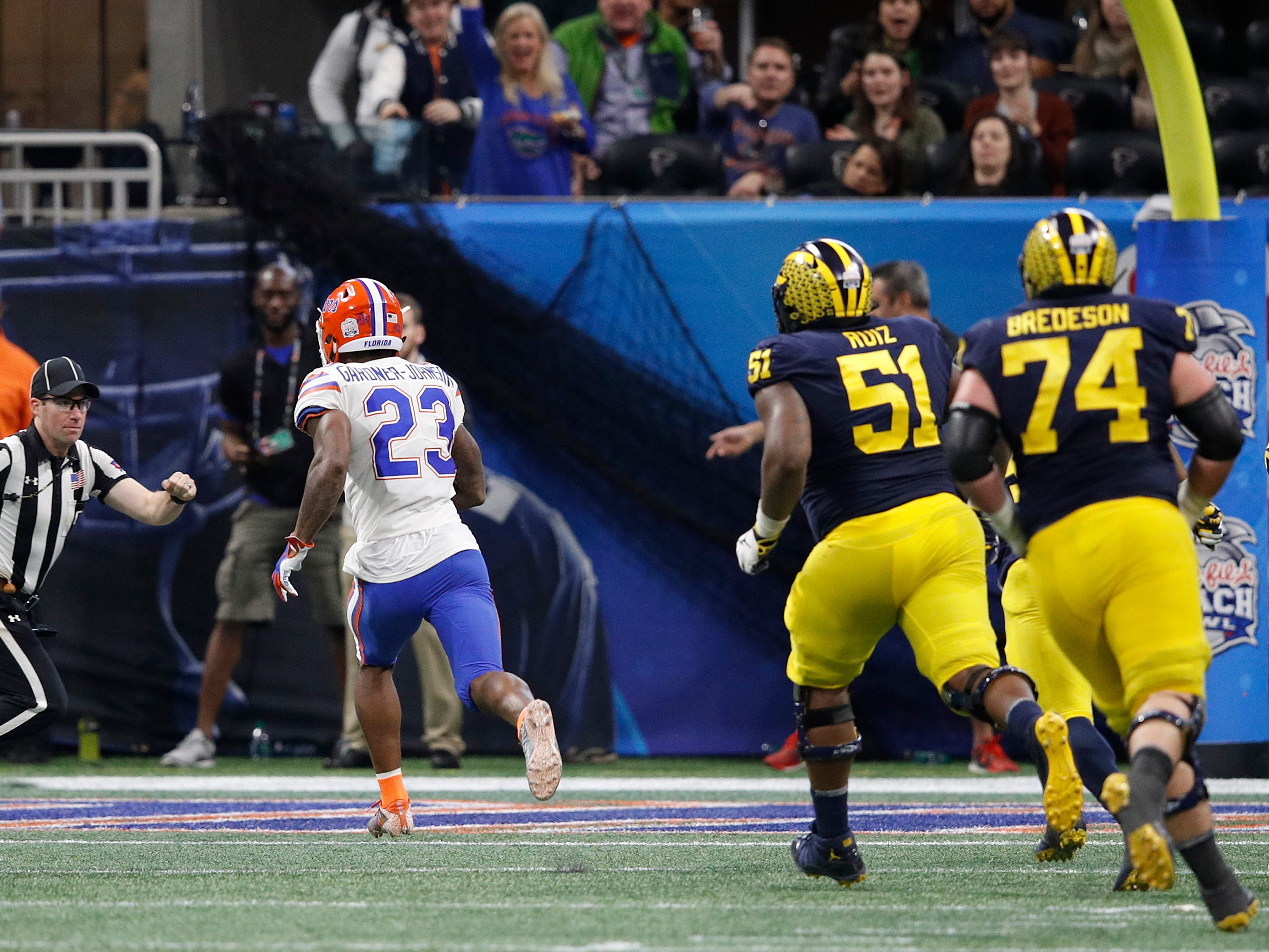 Florida defensive back Chauncey Gardner-Johnson returns an interception for a touchdown in the fourth quarter during U-M's 41-15 loss in the Peach Bowl on Saturday, Dec. 29, 2018, in Atlanta.
