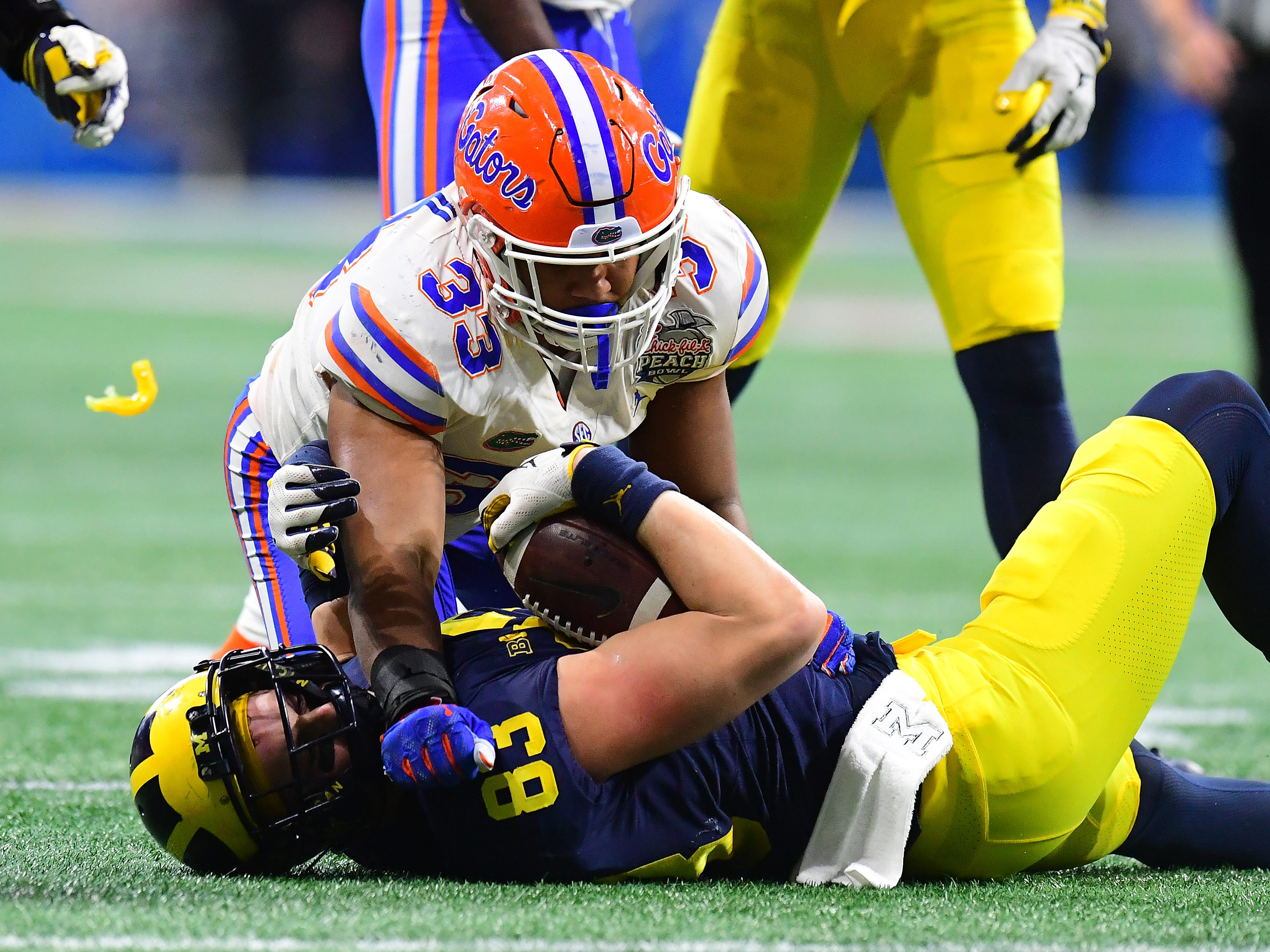 Michigan tight end Zach Gentry is tackled by Florida's David Reese II in the third quarter during U-M's 41-15 loss in the Peach Bowl on Saturday, Dec. 29, 2018, in Atlanta.
