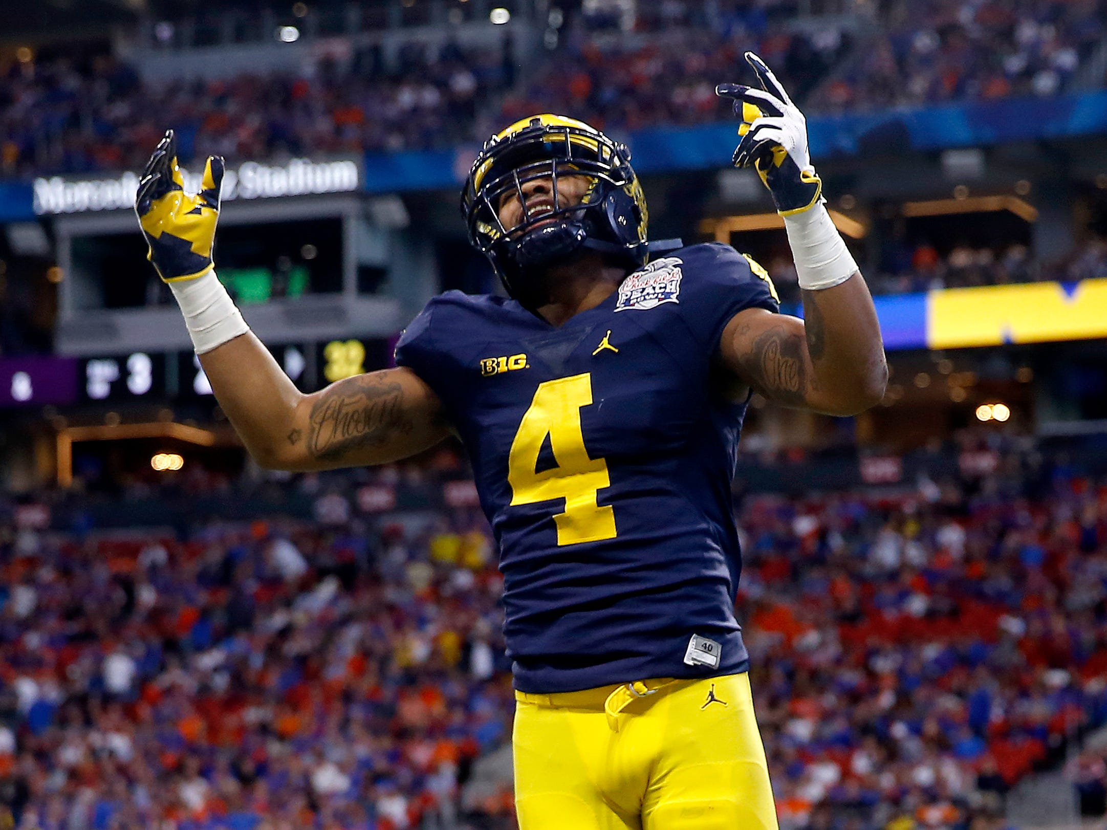 Michigan wide receiver Nico Collins celebrates a touchdown by teammate Donovan Peoples-Jones against Florida during the Peach Bowl on Saturday, Dec. 29, 2018, in Atlanta.