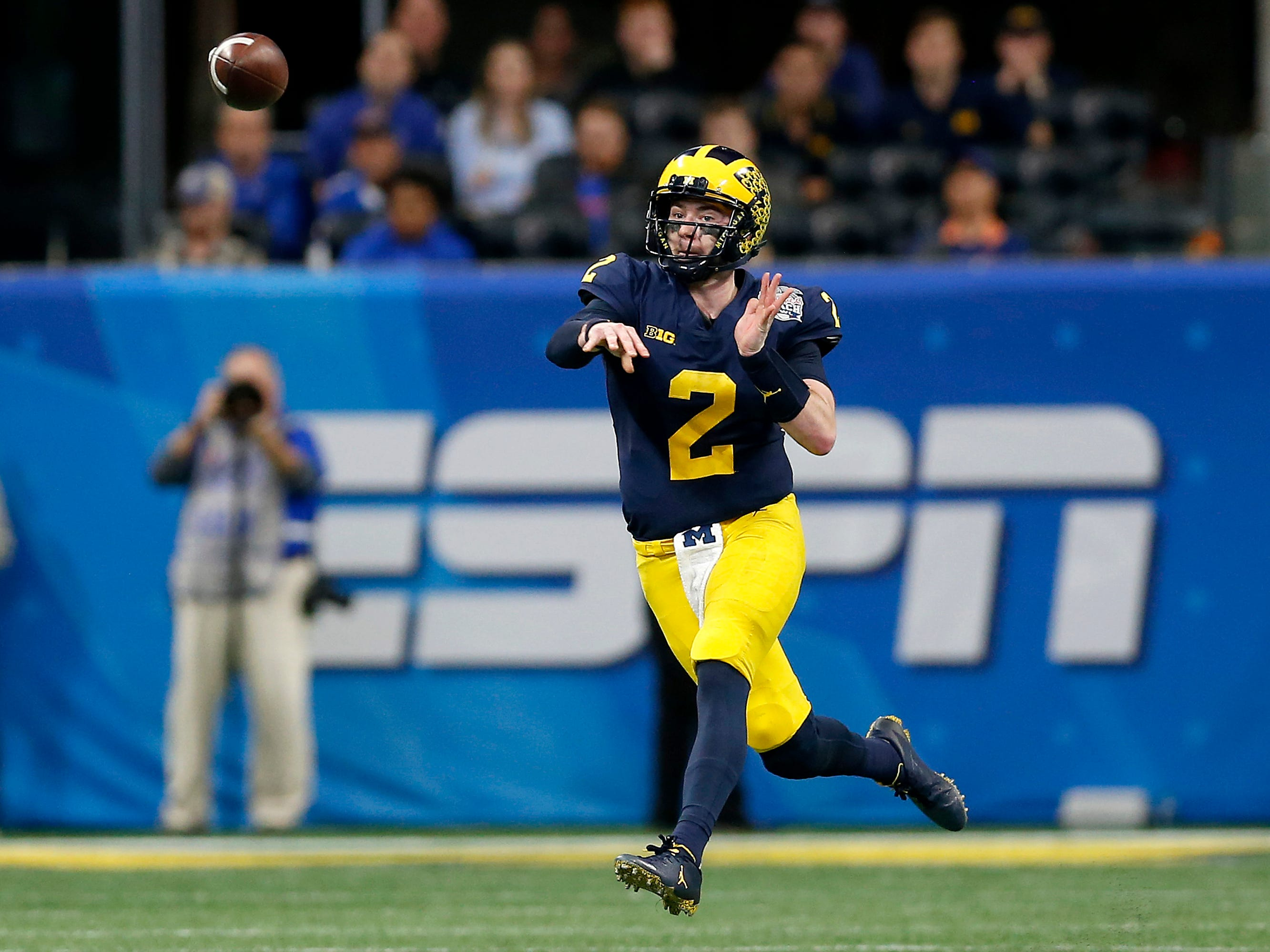 Michigan quarterback Shea Patterson attempts a pass in the first quarter during the Peach Bowl on Saturday, Dec. 29, 2018 in Atlanta.