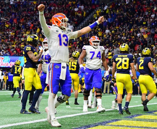 Florida QB Feleipe Franks celebrates a touchdown by teammate Jordan Scarlett (not pictured) against Michigan during the first half on Saturday, Dec. 29, 2018, in Atlanta.