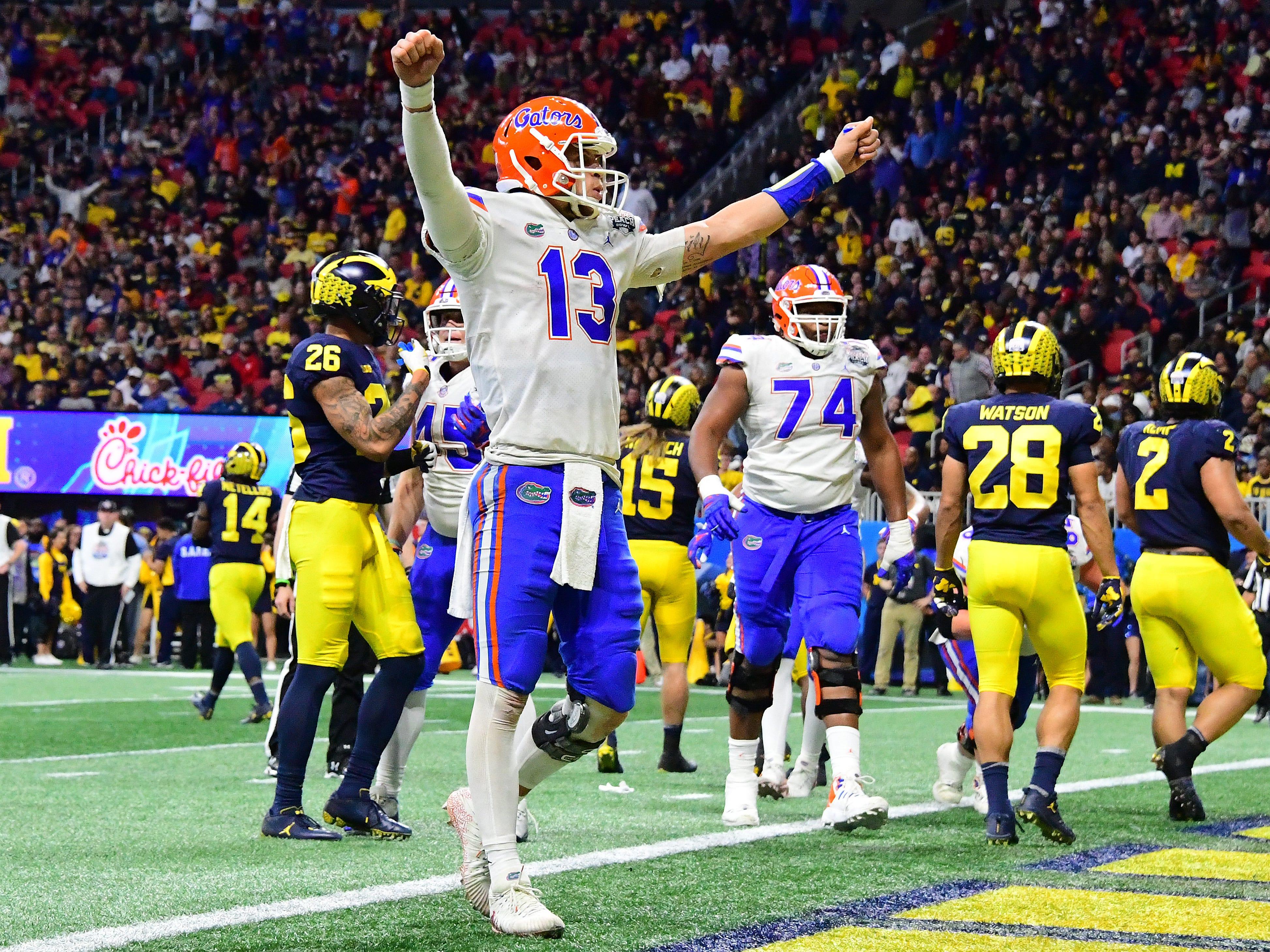 Florida QB Feleipe Franks celebrates a touchdown by teammate Jordan Scarlett (not pictured) against Michigan during the first half on Saturday, Dec. 29, 2018, in Atlanta.