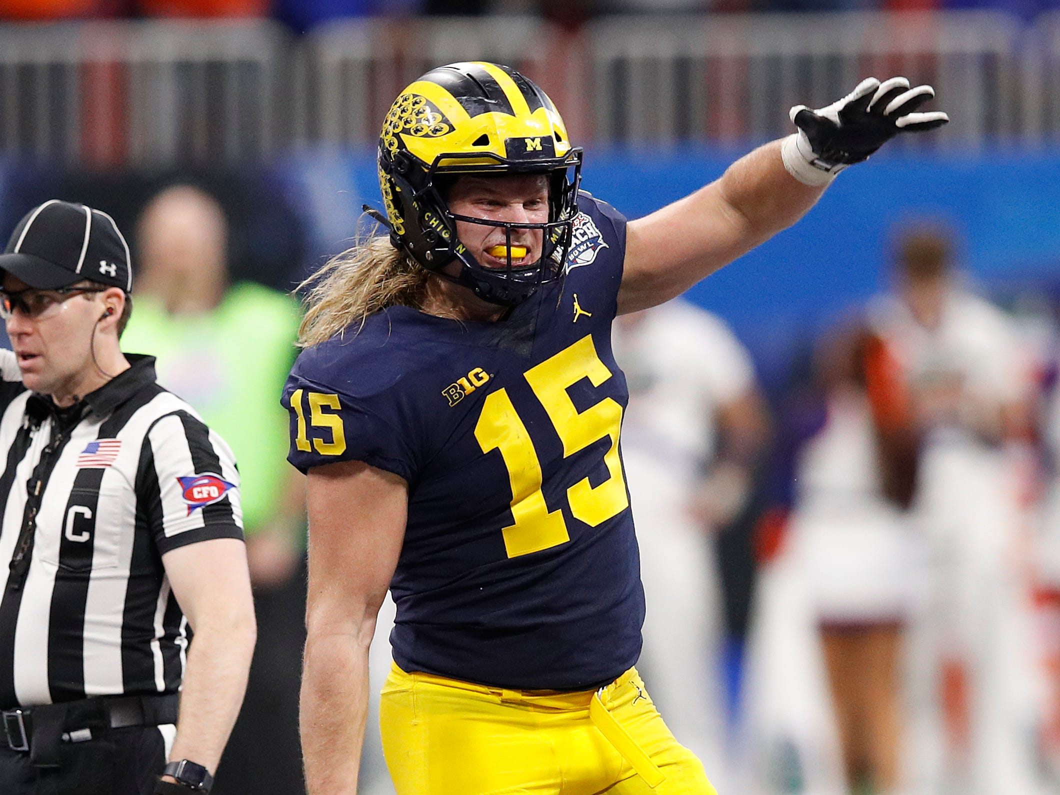 Michigan defensive lineman Chase Winovich celebrates a tackle in the third quarter against Florida during the first half on Saturday, Dec. 29, 2018, in Atlanta.