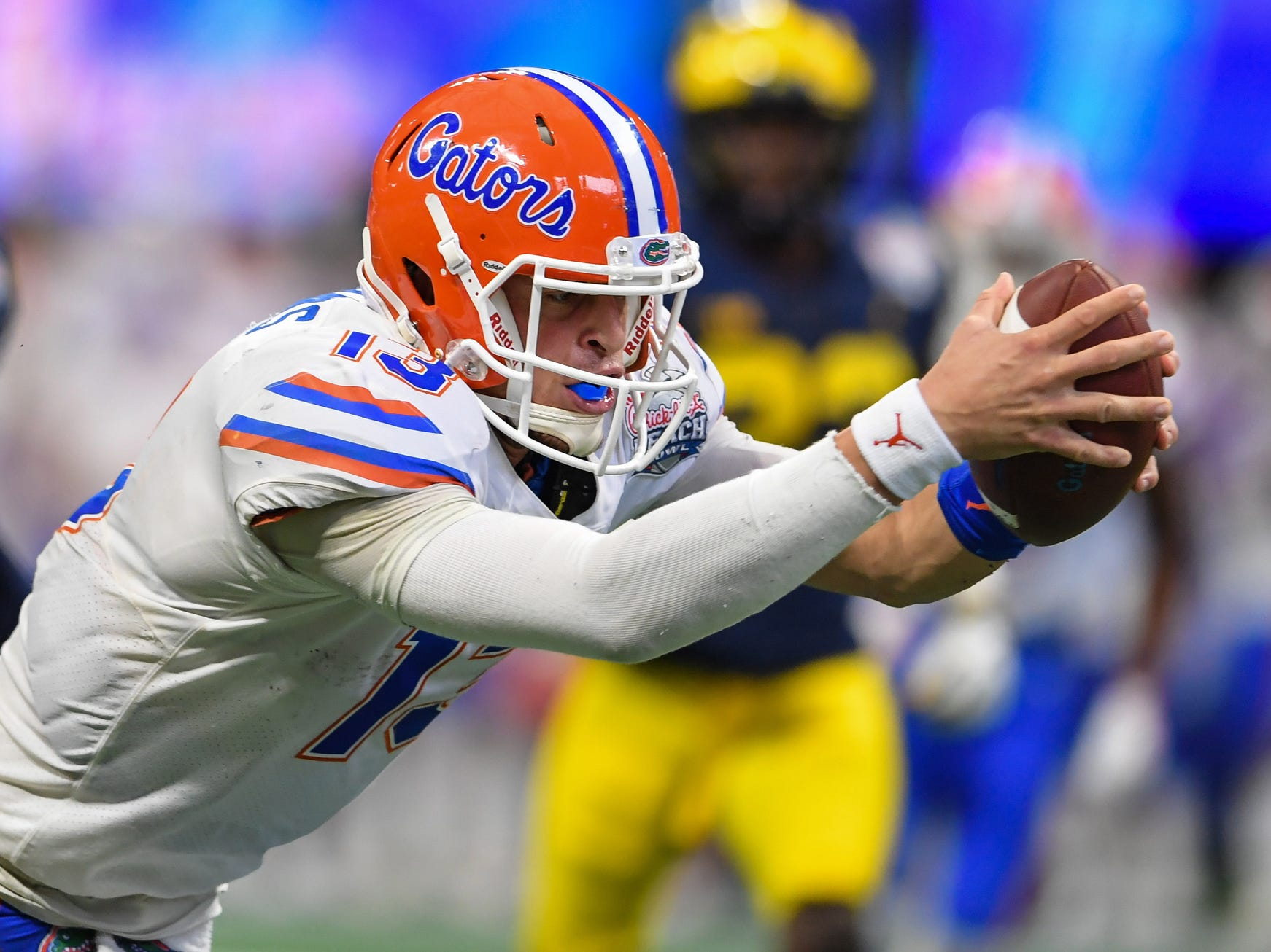 Florida Gators quarterback Feleipe Franks dives for a touchdown against Michigan during the first half during the Peach Bowl on Saturday, Dec. 29, 2018, in Atlanta.