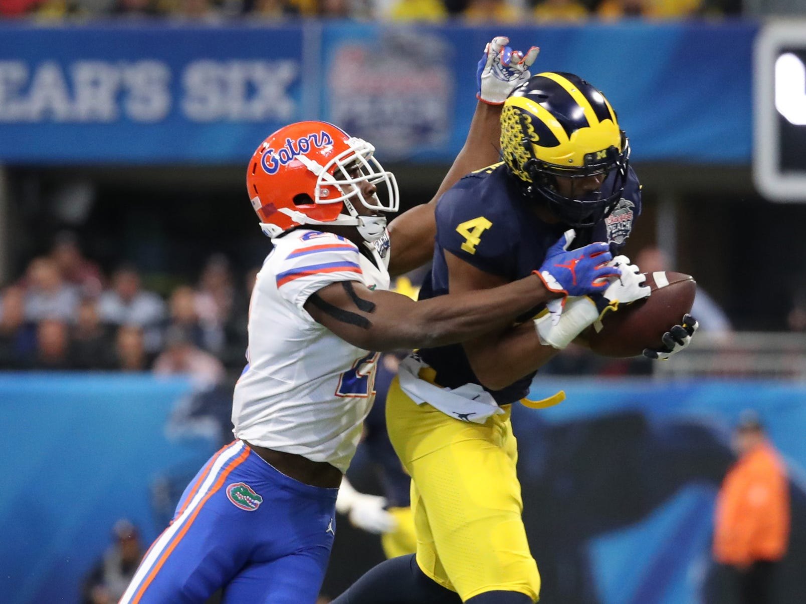 Michigan receiver Nico Collins makes a catch against Florida's Trey Dean III during the first half of the Peach Bowl on Saturday, Dec. 29, 2018, in Atlanta.