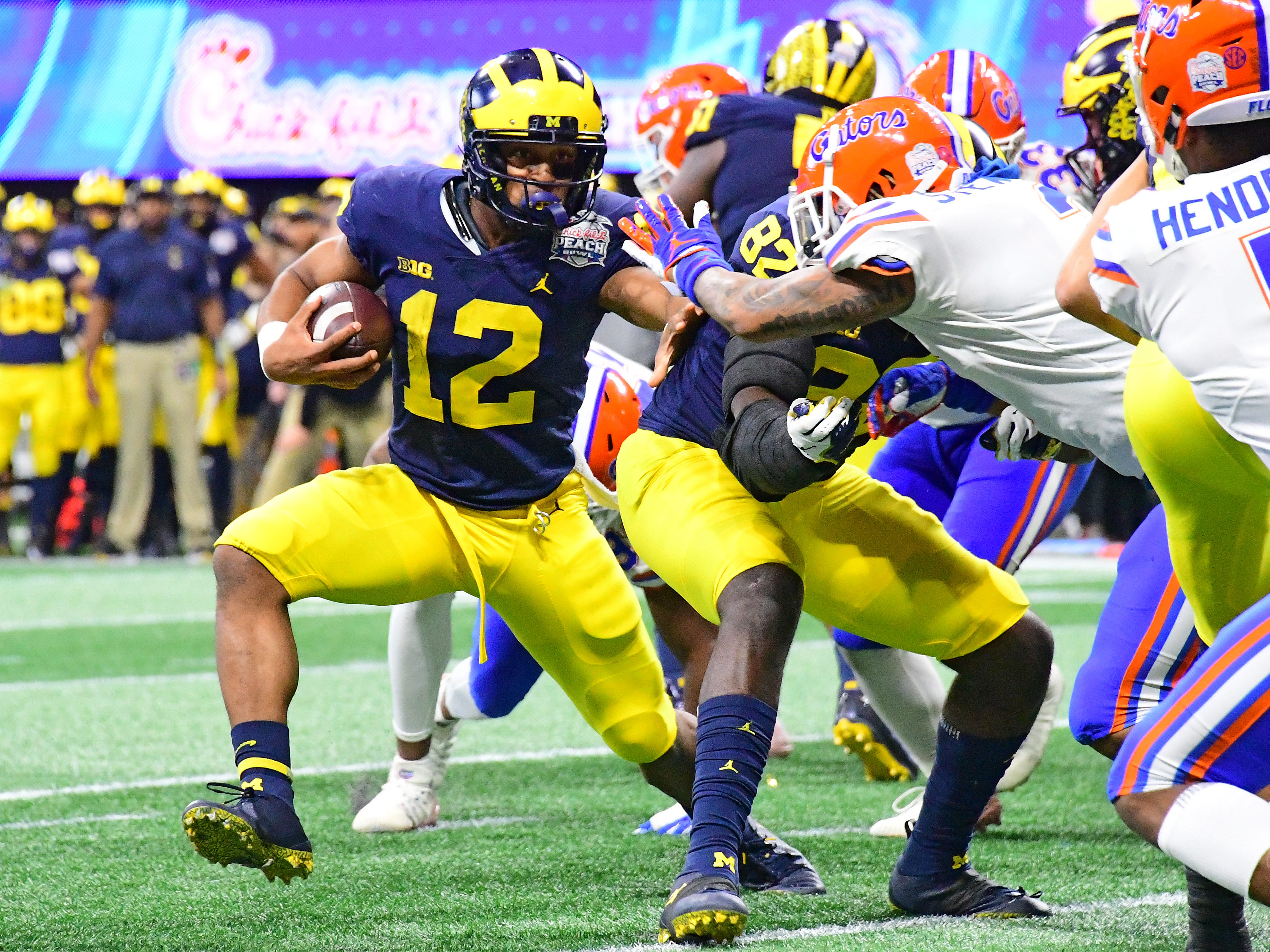 Michigan Wolverines' Chris Evans runs the ball against the Florida Gators in the fourth quarter of the Peach Bowl at Mercedes-Benz Stadium on Dec. 29, 2018 in Atlanta.