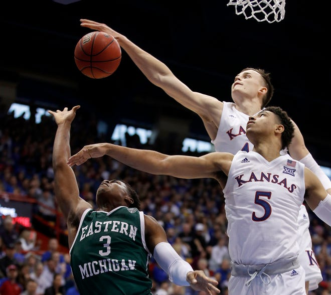 Kansas' Mitch Lightfoot, back, and Quentin Grimes (5) block a shot by Eastern Michigan's Paul Jackson (3) during the second half Saturday in Lawrence, Kan. Kansas won 87-63.