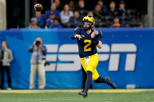 Michigan's Shea Patterson attempts a pass against Florida during the Peach Bowl.