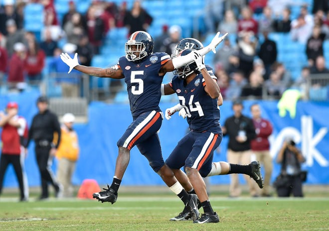 Tim Harris of the Virginia Cavaliers reacts after intercepting a pass.