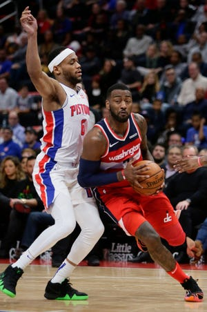 Wizards guard John Wall, right, was just the latest tough defensive assignment for Pistons guard Bruce Brown this season.