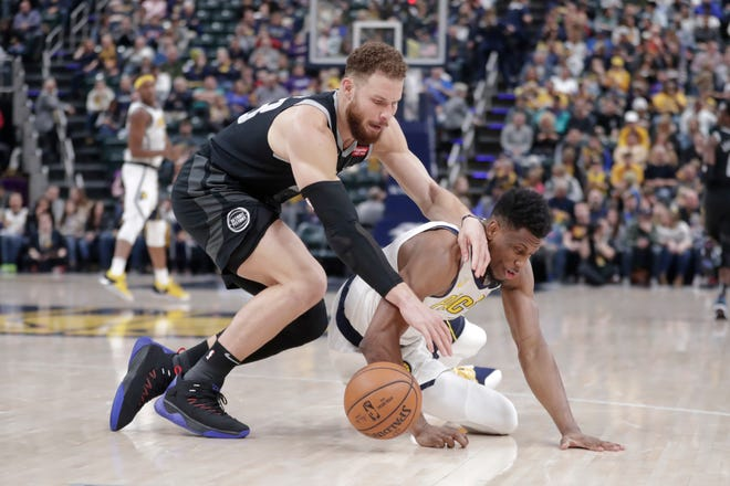 Indiana Pacers forward Thaddeus Young, right, steals the ball from Detroit Pistons forward Blake Griffin during the second half on Friday.