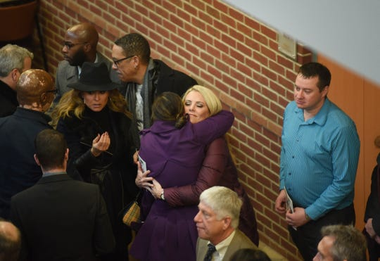 Fox 2 Detroit reporter Amy Andrews gets a hug during a celebration of life service for Jessica Starr. Fox 2 reporter Tayrn Asher stands next to them