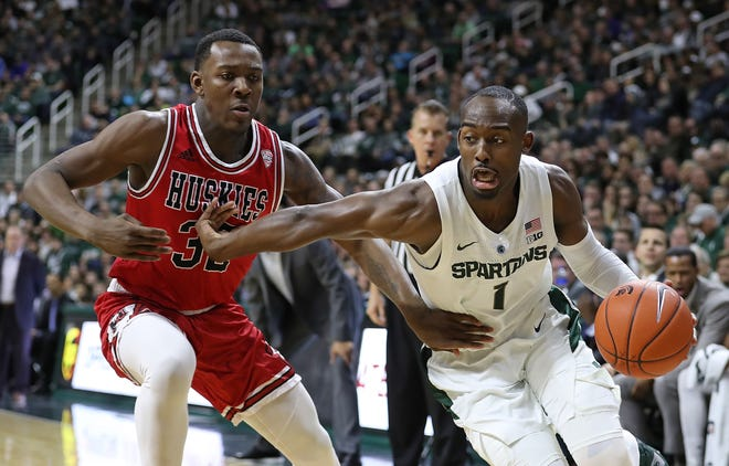 Michigan State's Joshua Langford was 1-of-8 in the first half and sat after tweaking his ankle.