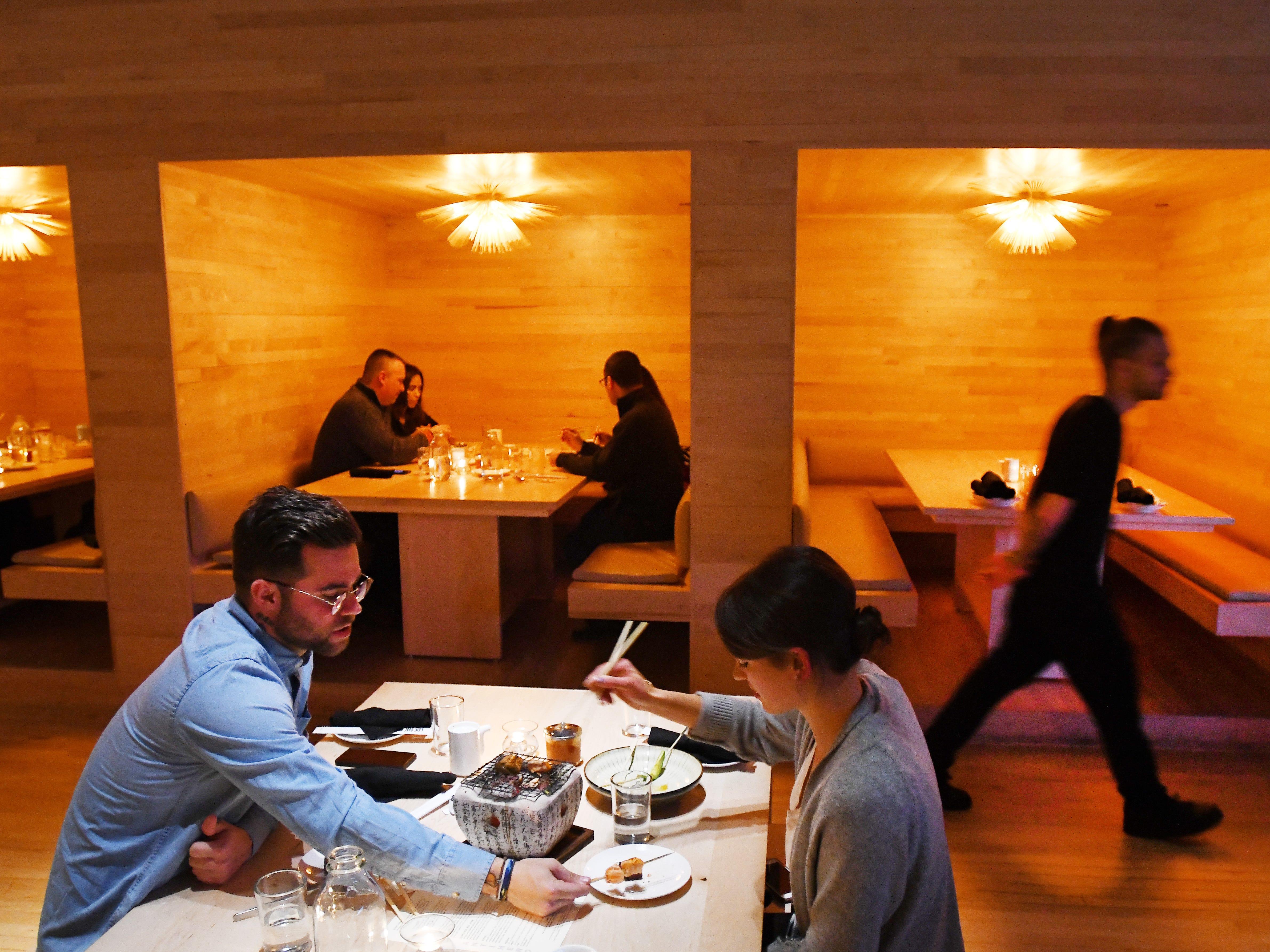 Alexandra McLeod and Alan Wheeler enjoy a hibachi at their table.