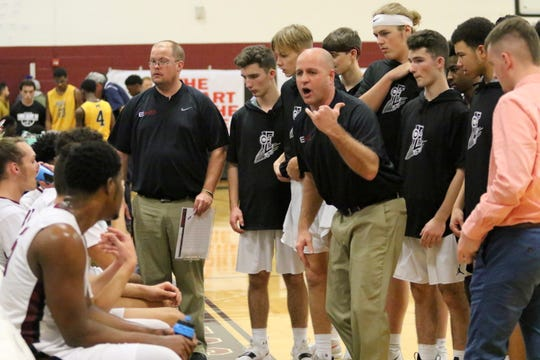 Elmira head coach Ryan Johnson talks to his team during a teammate against Mount St. Michael on Dec. 28, 2018 at the Josh Palmer Fund Elmira Holiday Inn Classic at Elmira High School.