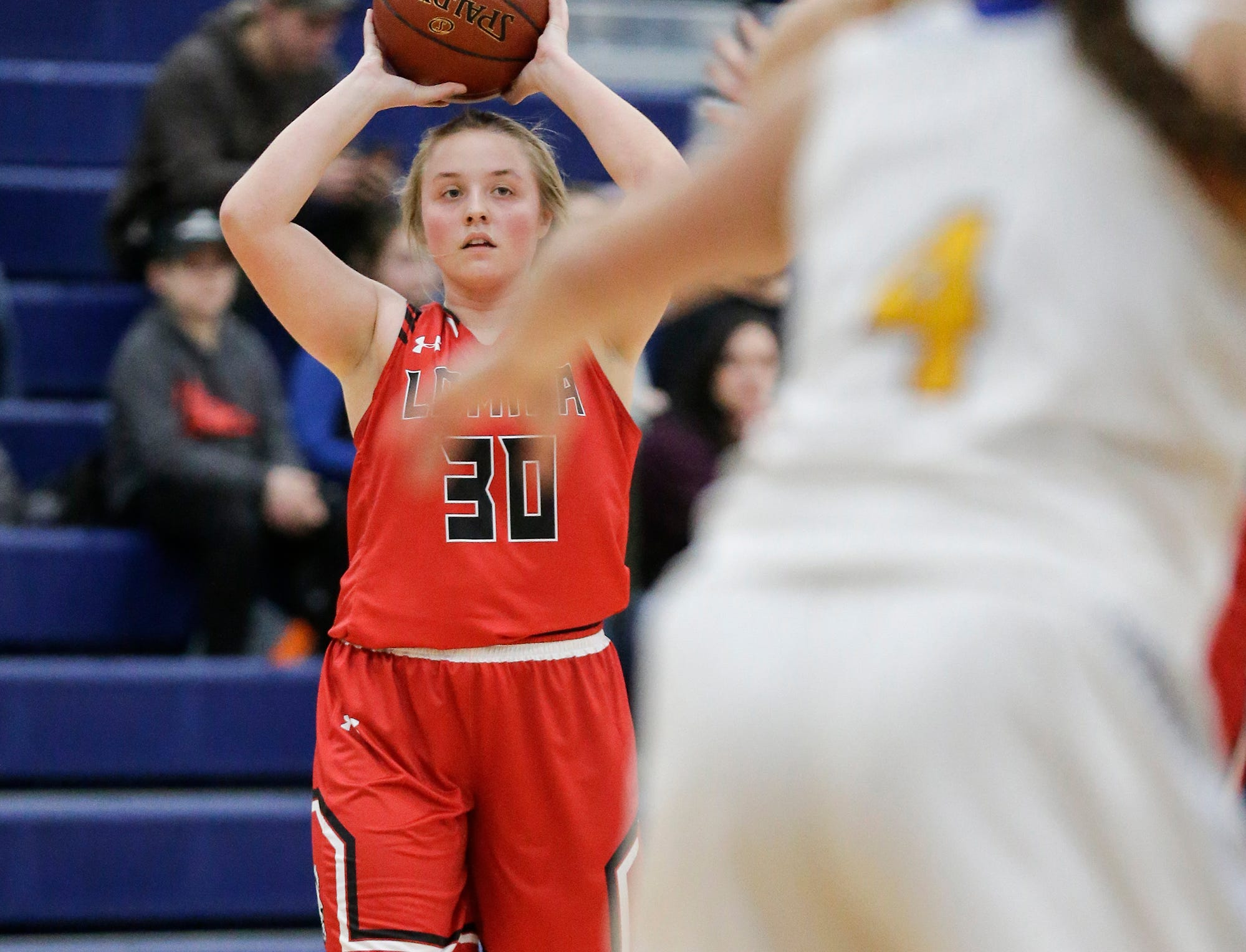 Lomira High School girls basketball's Erin Ries looks to pass the ball against Campbellsport High School during their game Friday, December 28, 2018 in Campbellsport. Doug Raflik/USA TODAY NETWORK-Wisconsin