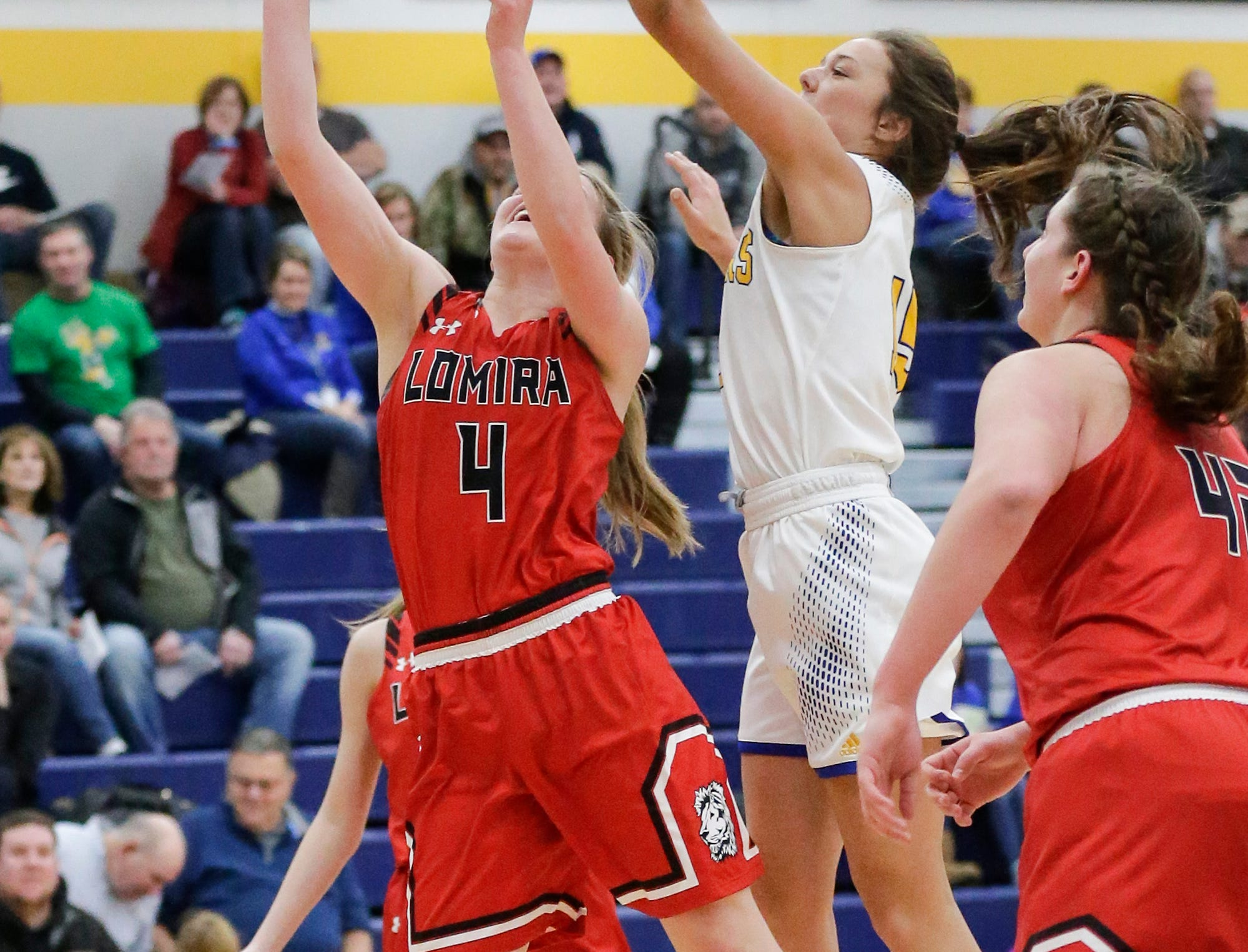 Campbellsport High School girls basketball's Grace Nerat gets a piece of the ball while Lomira High School's Elizabeth Wulff attempts a basket during their game Friday, December 28, 2018 in Campbellsport. Doug Raflik/USA TODAY NETWORK-Wisconsin
