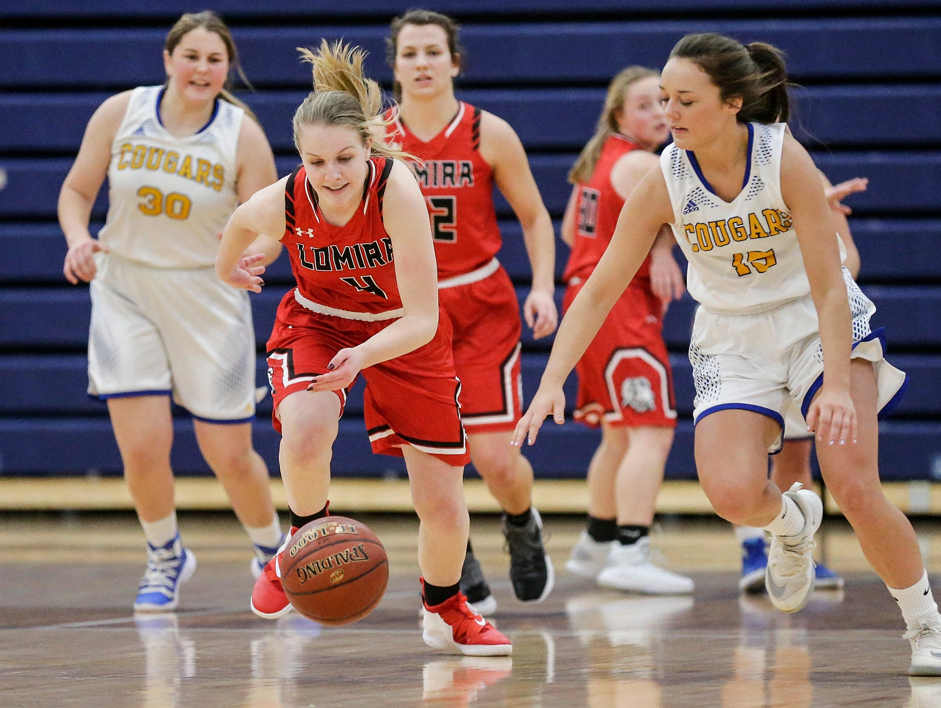 Lomira High School girls basketball's Elizabeth Wulff and Campbellsport High School's Grace Nerat race after a loose ball during their game Friday, December 28, 2018 in Campbellsport. Doug Raflik/USA TODAY NETWORK-Wisconsin