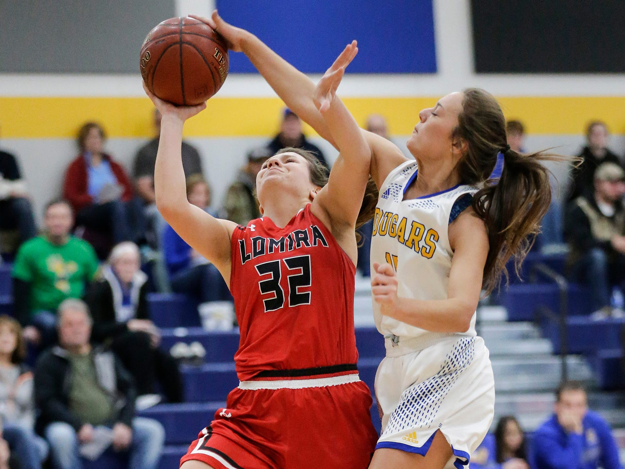 Lomira High School girls basketball's Crystal Geiger gets fouled by Campbellsport High School's Grace Nerat during their game Friday, December 28, 2018 in Campbellsport.