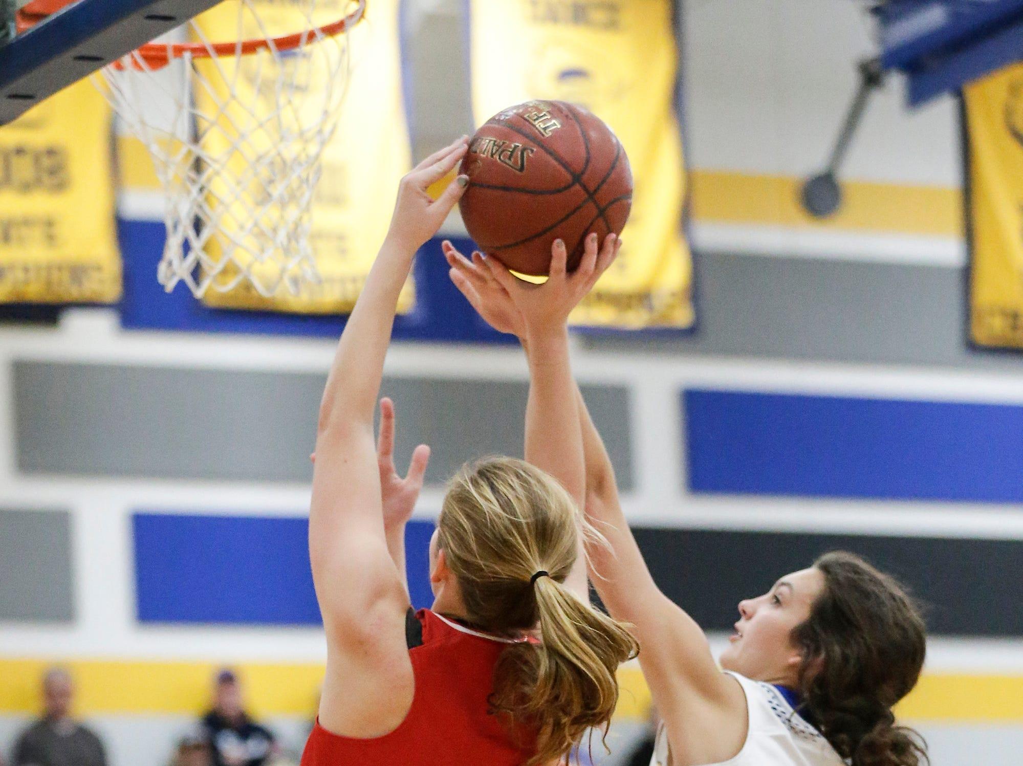 Lomira High School girls basketball's Gabriella Luecke attempts a basket against Campbellsport High School's Madysen Janke during their game Friday, December 28, 2018 in Campbellsport. Doug Raflik/USA TODAY NETWORK-Wisconsin