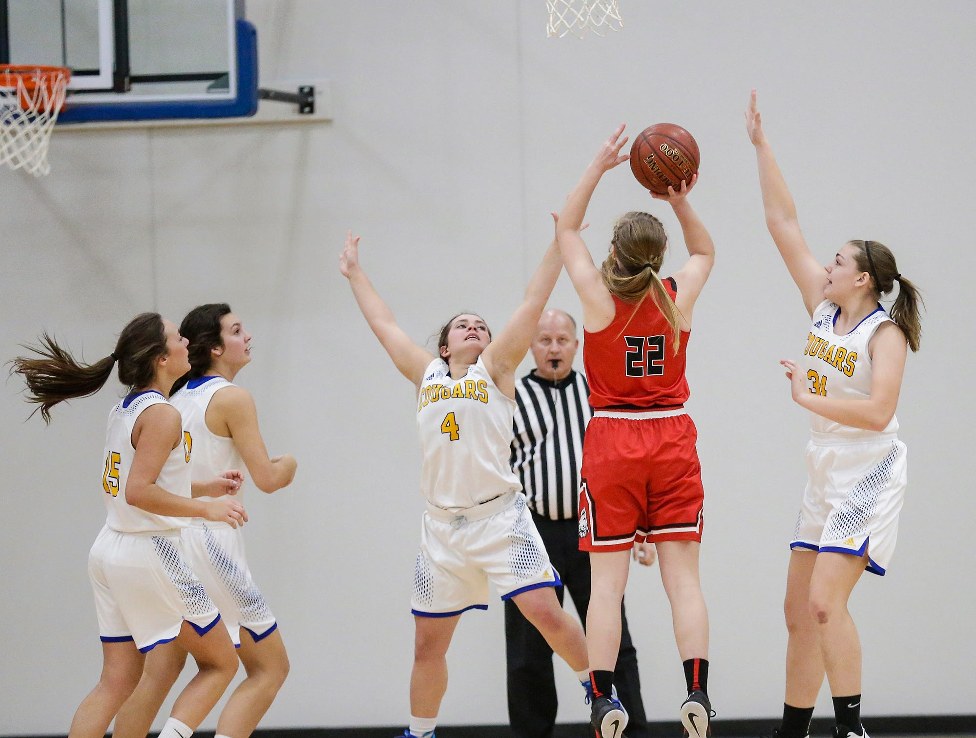 Lomira High School girls basketball's Moira Puls goes up for a basket between Campbellsport High School's Evonna Engel (4) and Kaianne Hodorff (34) during their game Friday, December 28, 2018 in Campbellsport. Doug Raflik/USA TODAY NETWORK-Wisconsin
