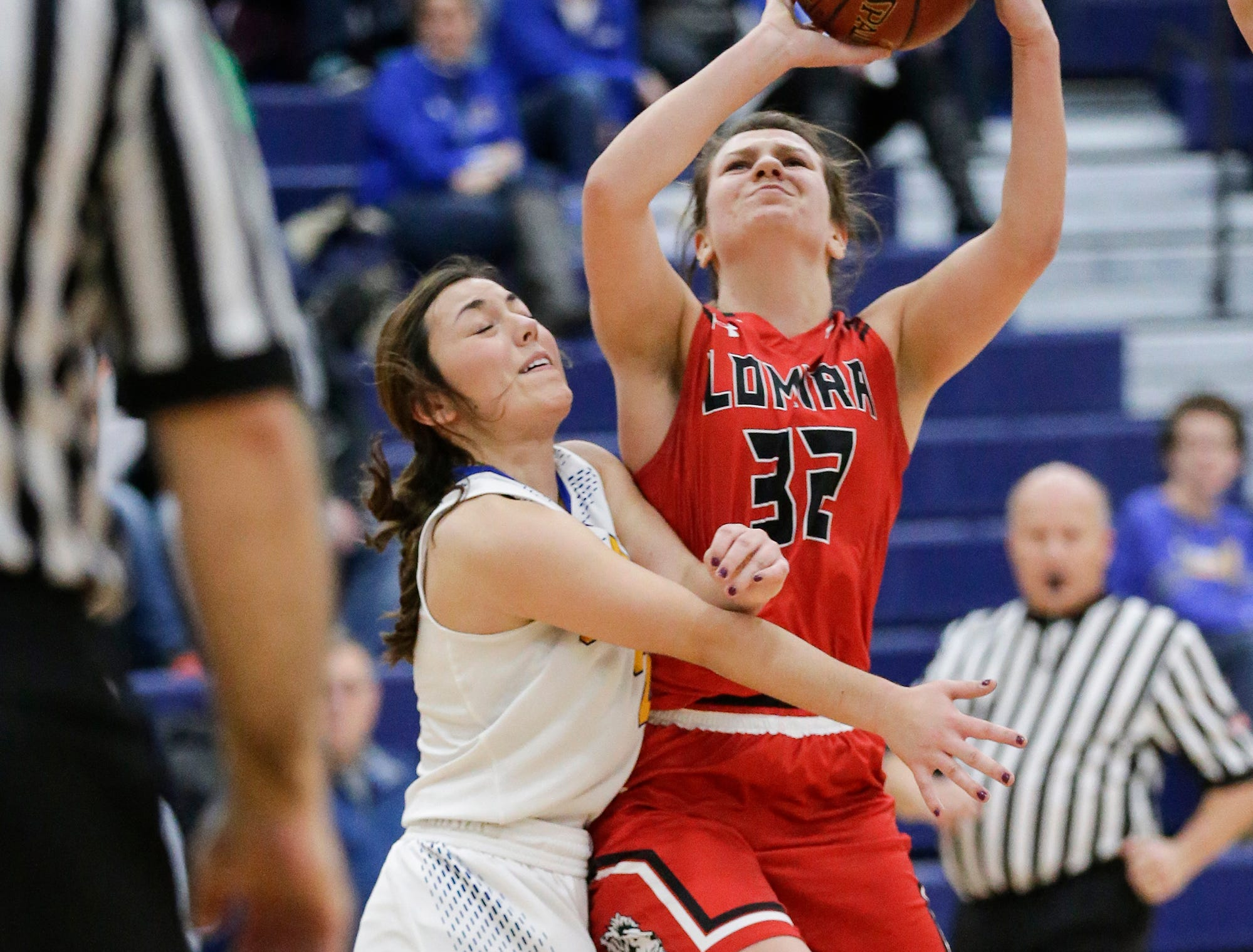 Lomira High School girls basketball's Crystal Geiger gets fouled by Campbellsport High School's Amber Kissinger during their game Friday, December 28, 2018 in Campbellsport. Doug Raflik/USA TODAY NETWORK-Wisconsin