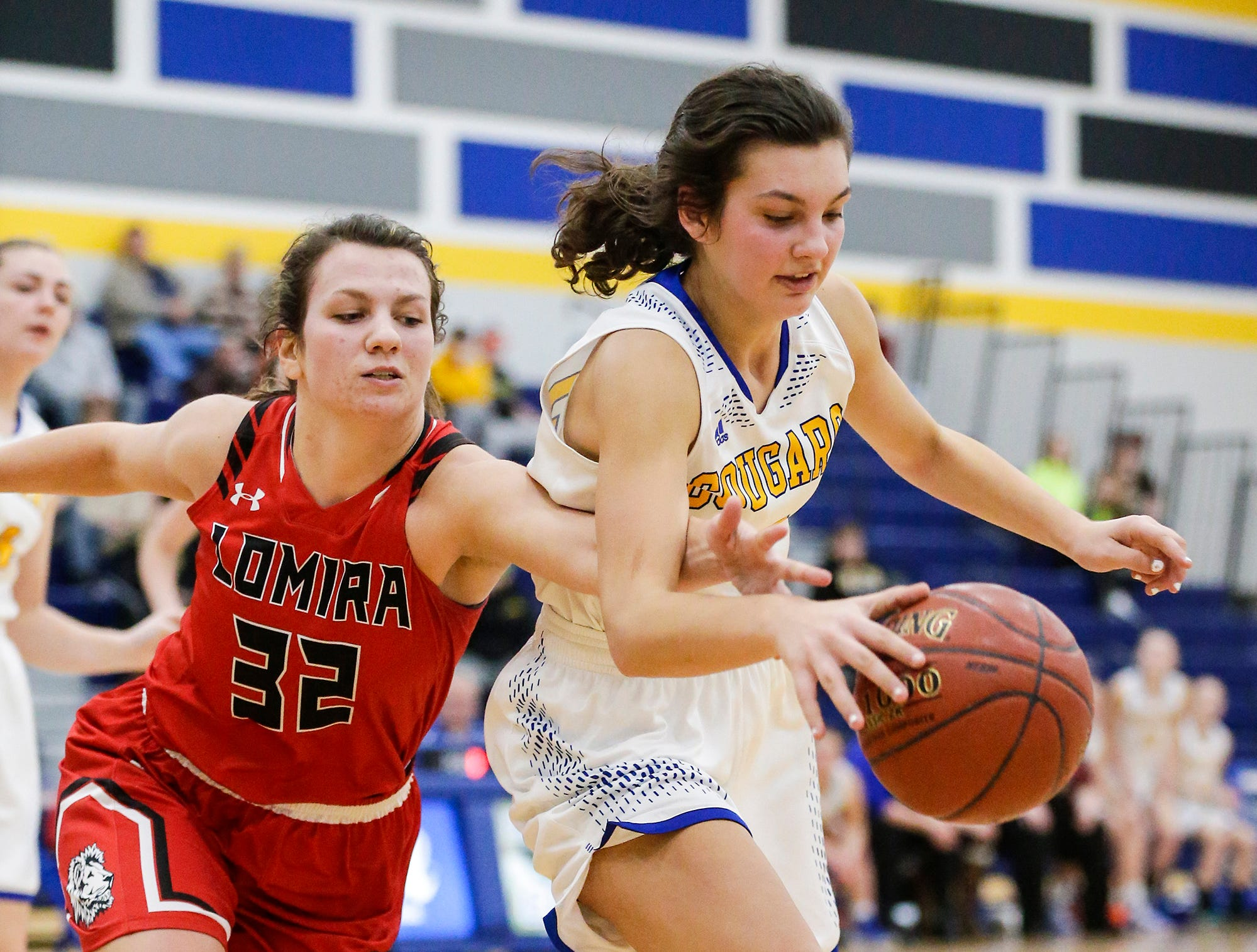 Lomira High School girls basketball's Crystal Geiger and Campbellsport High School's Madilyn Danza scramble for a rebound during their game Friday, December 28, 2018 in Campbellsport. Doug Raflik/USA TODAY NETWORK-Wisconsin