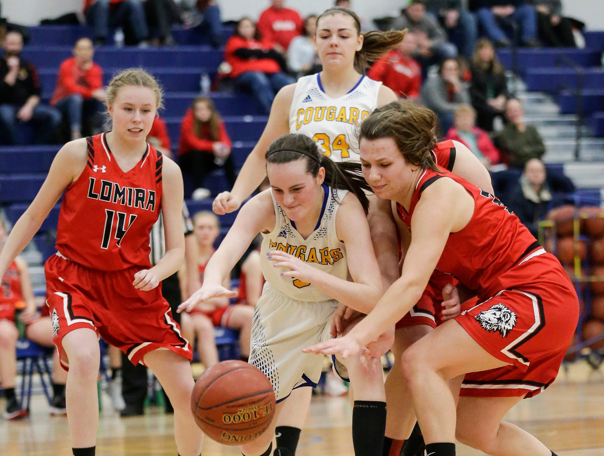 Campbellsport High School girls basketball's Morgan Fryman and Lomira High School's Crystal Geiger reach for a loose ball during their game Friday, December 28, 2018 in Campbellsport. Doug Raflik/USA TODAY NETWORK-Wisconsin