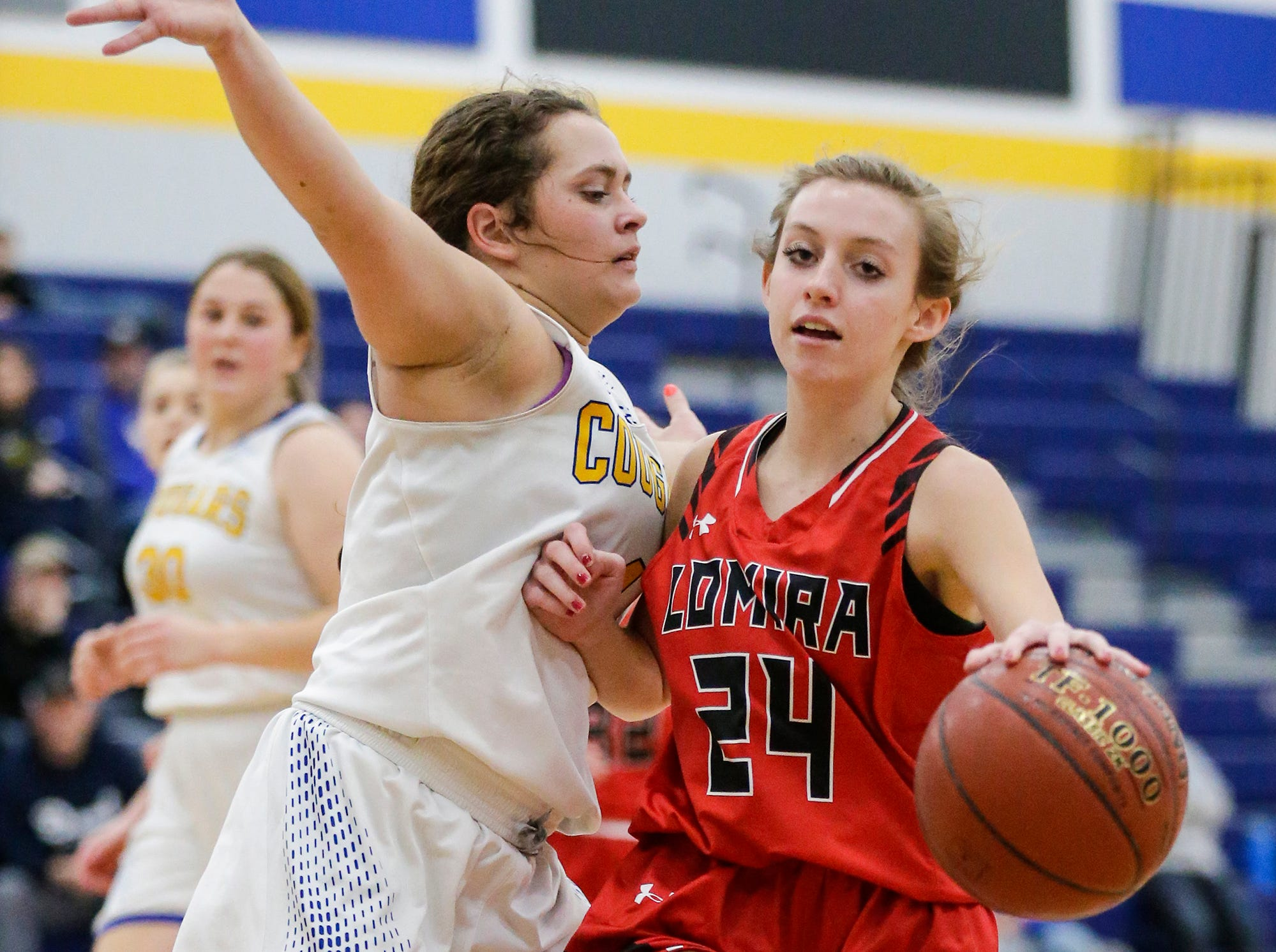 Lomira High School girls basketball's Kailin Brath attempts to get around Campbellsport High School's Evonna Engel during their game Friday, December 28, 2018 in Campbellsport. Doug Raflik/USA TODAY NETWORK-Wisconsin