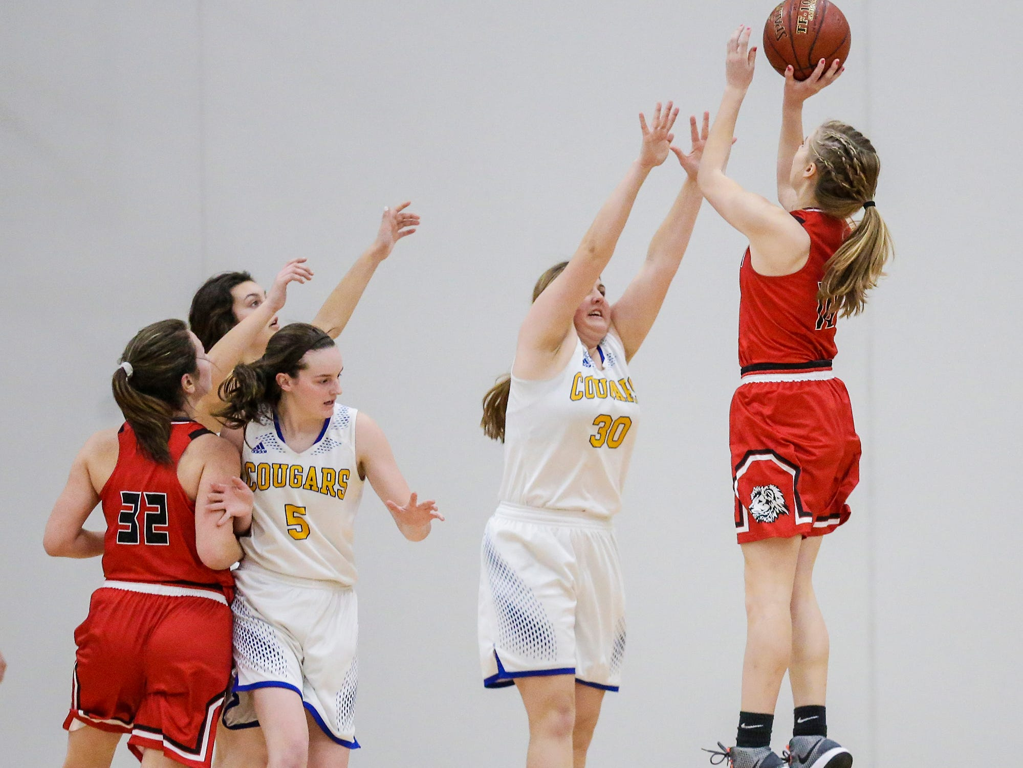 Lomira High School girls basketball's Autumn Schrauth shoots for a basket over Campbellsport High School's Shayley Narges during their game Friday, December 28, 2018 in Campbellsport. Doug Raflik/USA TODAY NETWORK-Wisconsin