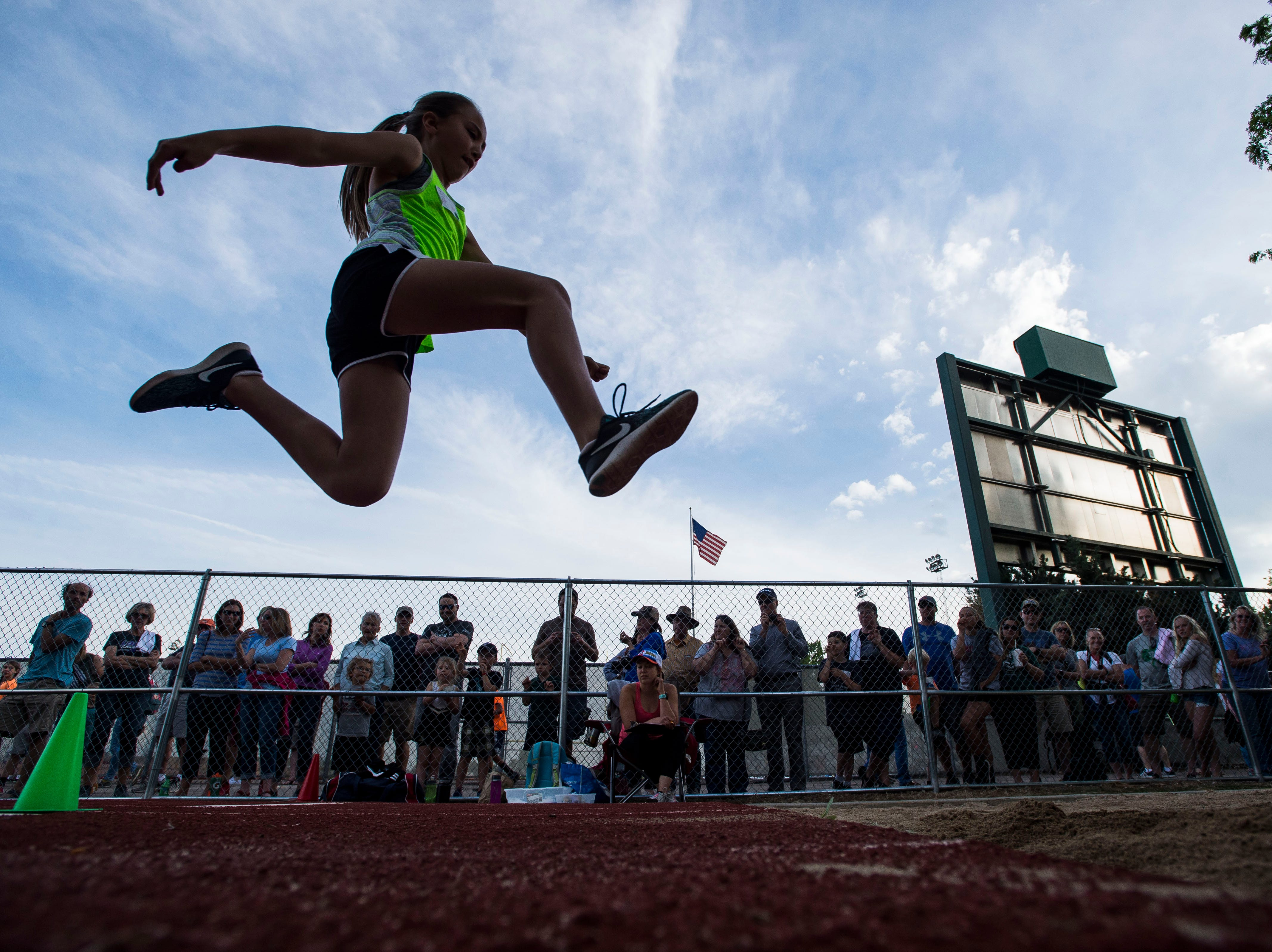 Dunn Elementary School fourth grader Ellia Beauprez competes in the long jump at the Poudre School District Manuel Cordova Elementary Track Meet on Monday, May 21, 2018, at French Field in Fort Collins, Colo.