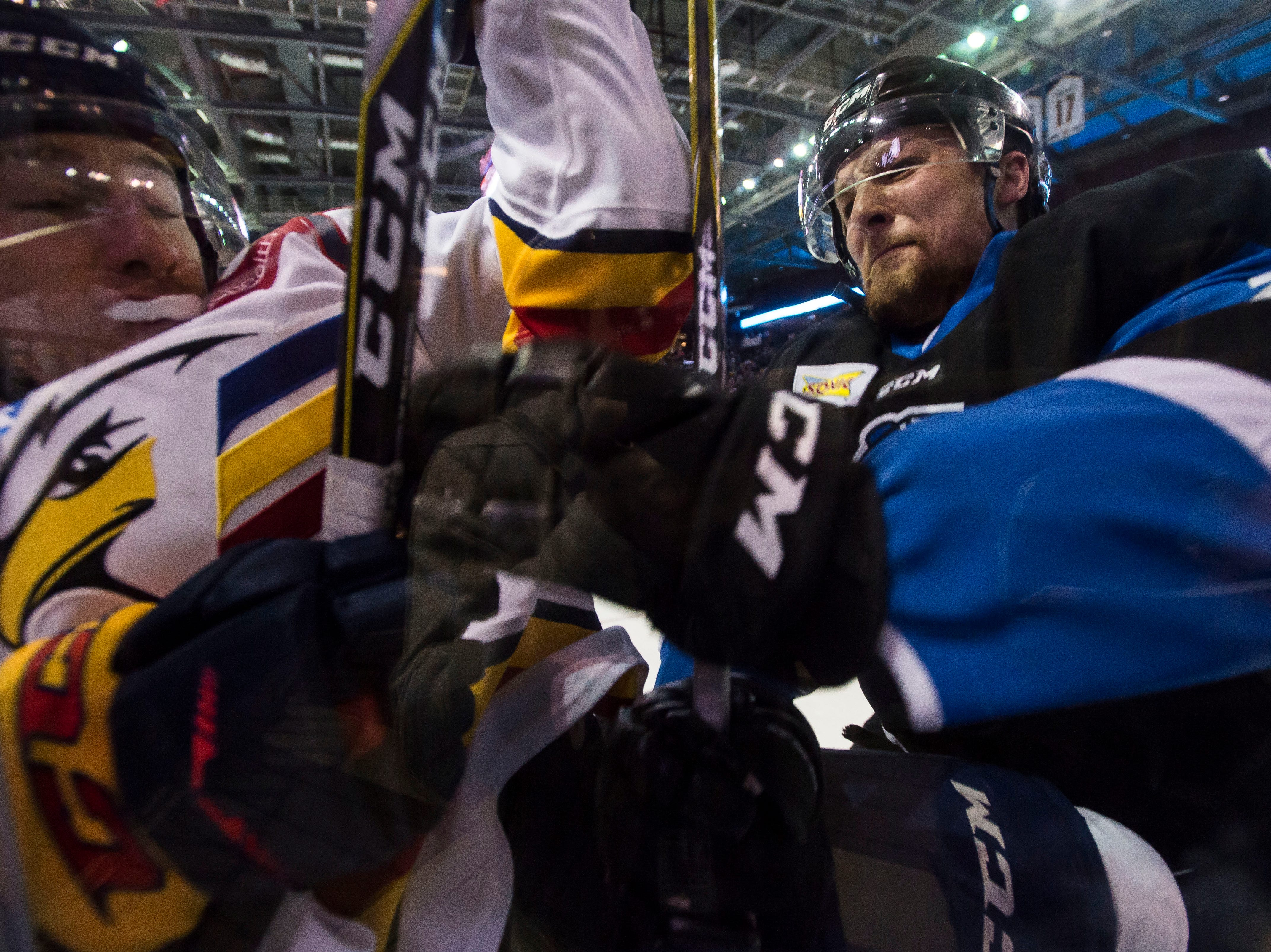 Colorado Eagles forward Matt Garbowsky (7) is checked by Wichita Thunder forward Mitch Maloney (23) on Wednesday, April 18, 2018, at the Budweiser Event Center in Loveland, Colo.