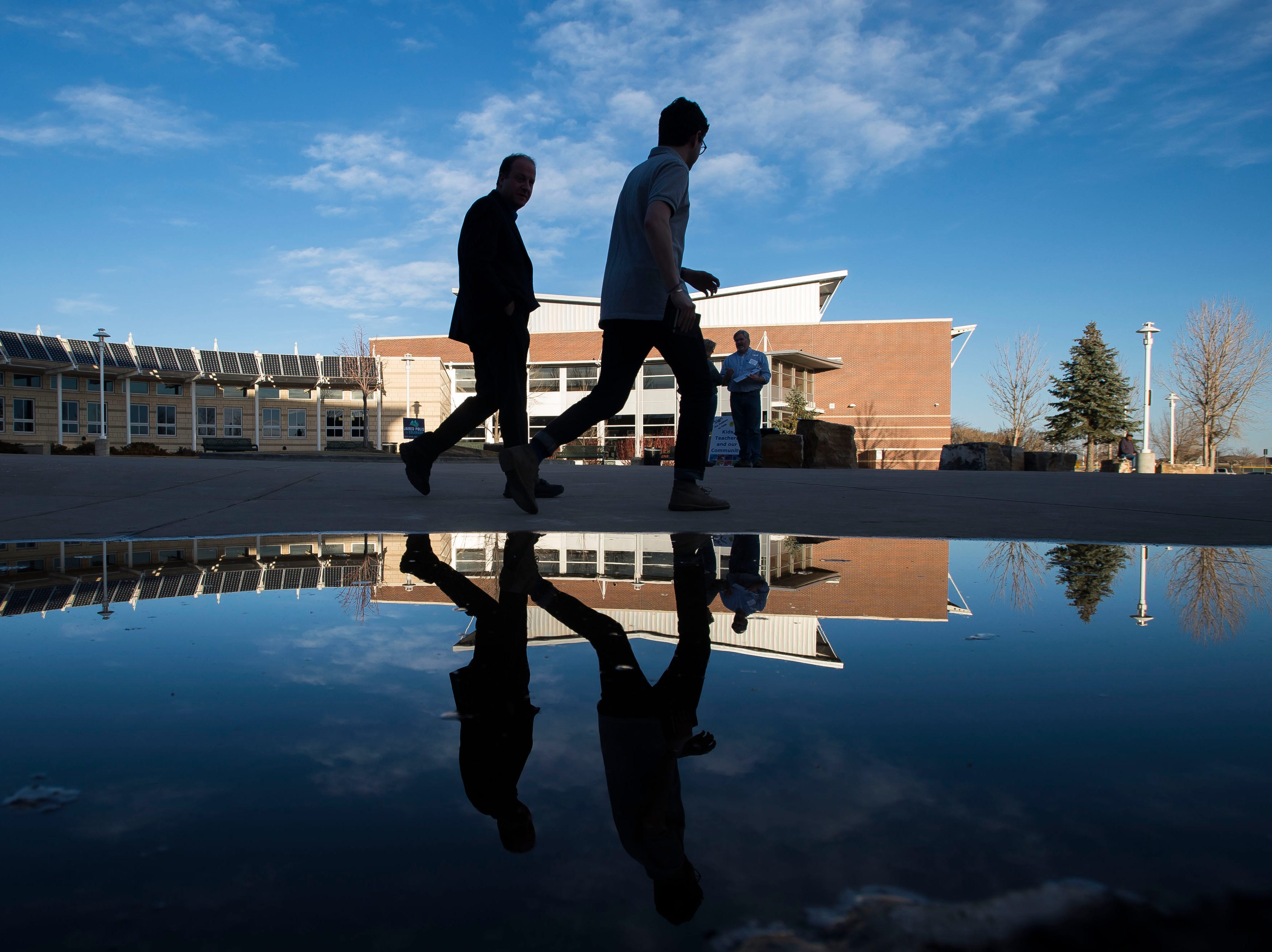 Colorado gubernatorial candidate Jared Polis, left, and his press secretary Eli Rosen head to the parking lot on Saturday, March 3, 2018, after participating in a forum for gubernatorial candidates at Fossil Ridge High School in Fort Collins, Colo.