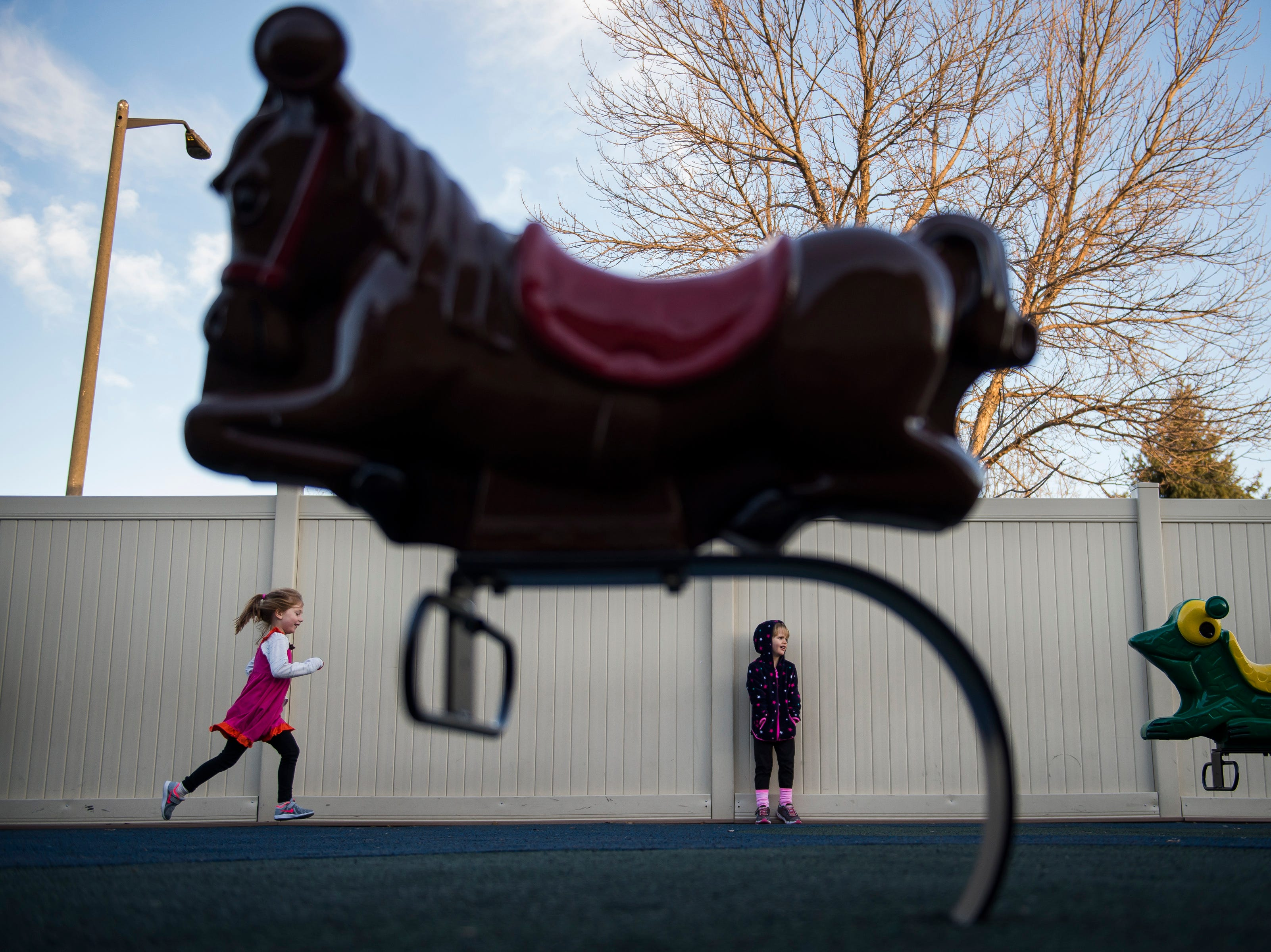 Scarlett Archer, 4, runs through the playground area while Roz Nitchie-Shonka looks on during a recess time on Thursday, Nov. 15, 2018, at The Learning Experience child development center in Fort Collins, Colo.