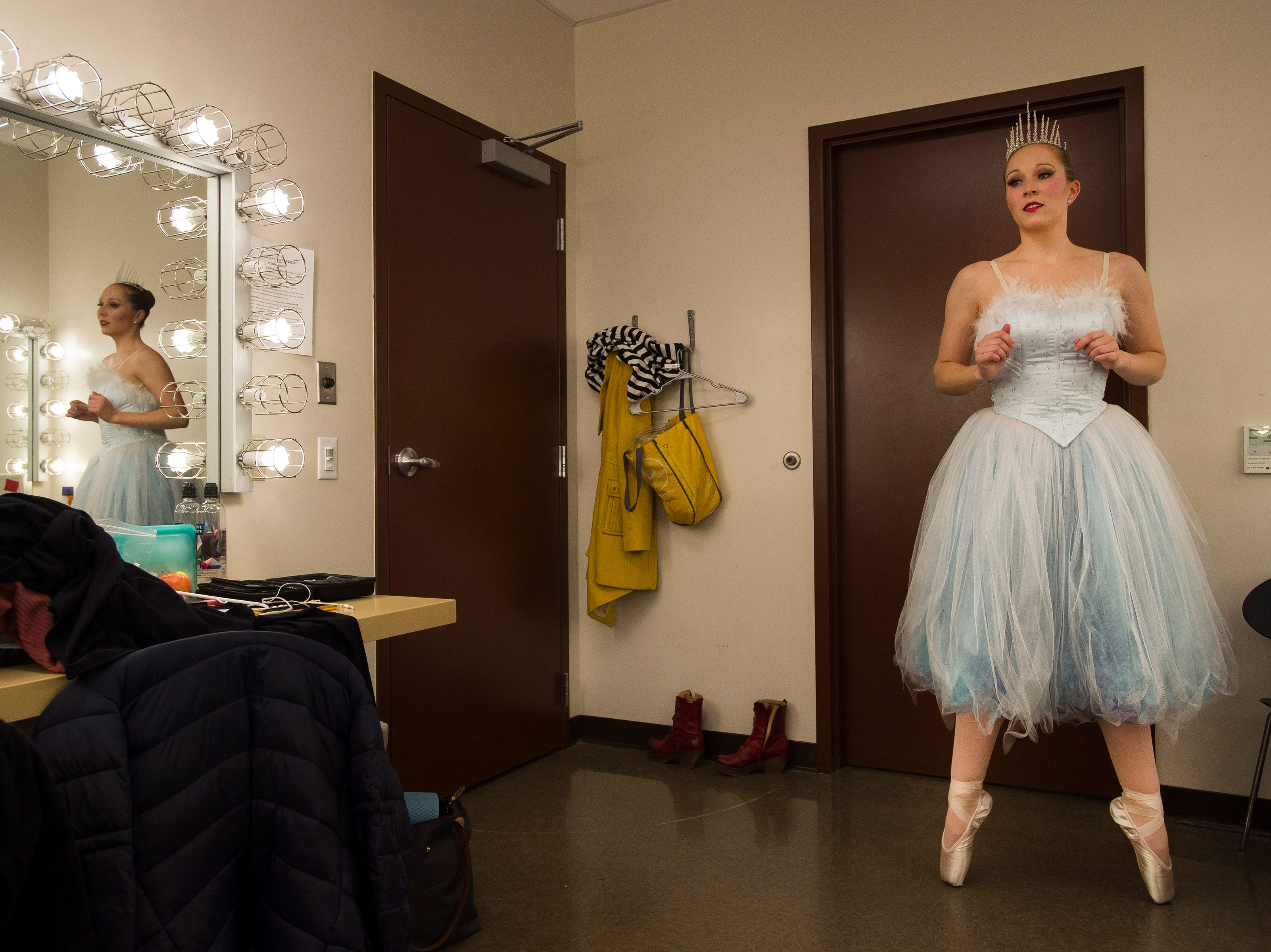 Rikke Liska limbers up in the dressing room during a rehearsal for The Nutcracker on Wednesday, Dec. 5, 2018, at the Lincoln Center in Fort Collins, Colo.