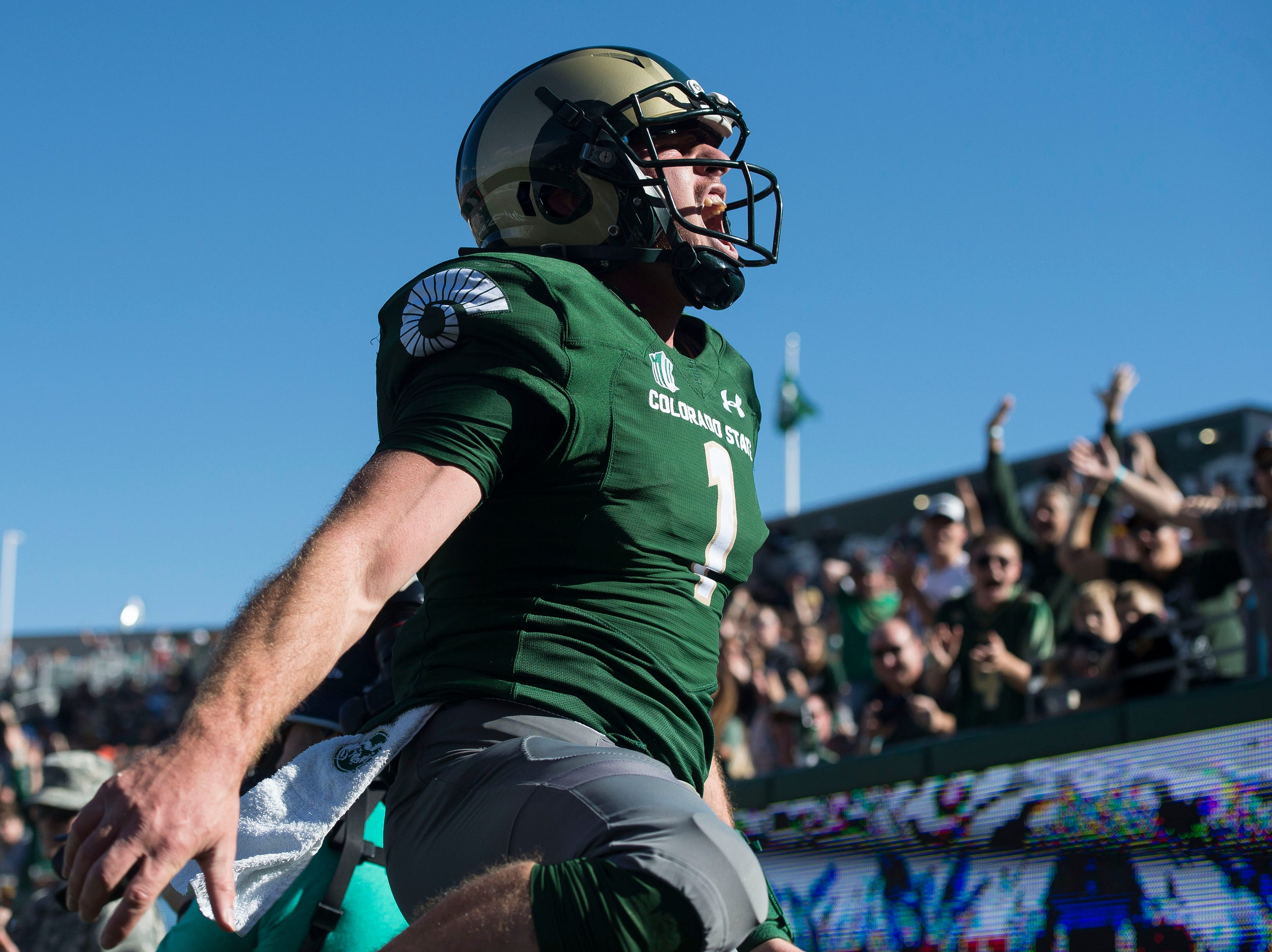 Colorado State University senior quarterback K.J. Carta-Samuels (1) celebrates a rushing touchdown during a game against New Mexico on Saturday, Oct. 13, 2018, at Canvas Stadium in Fort Collins, Colo.
