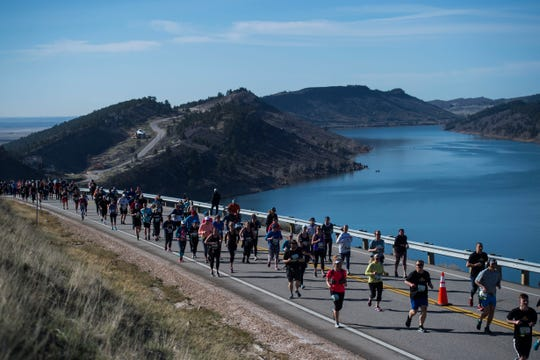 """Participants make their way up """"Monster Mountain"""" during the Horsetooth Half Marathon on Saturday, April 14, 2018, in Fort Collins, Colo."""