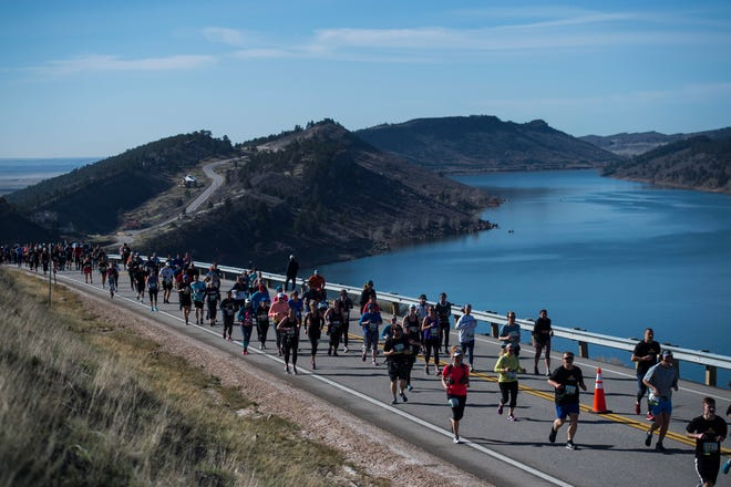 "Participants make their way up ""Monster Mountain"" during the Horsetooth Half Marathon on Saturday, April 14, 2018, in Fort Collins, Colo."