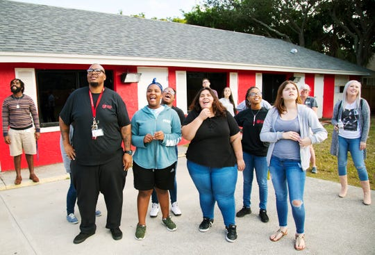 Erick Scott Sr., second from left, a shift supervisor at Oasis Youth Shelter in Fort Myers, leads a coping exercise recently. The shelter serves teenagers who have stopped going to school, runaways and foster kids. Earlier this year Scott won Youth Care Worker of 2018 out of 700 potential candidates from the nonprofit Florida Network of Youth and Family Services.