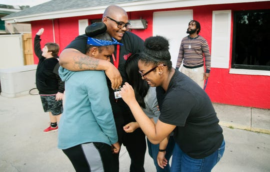 """""""You got to be able to meet these kids where they are,"""" says Erick Scott Sr., center, a shift supervisor at Oasis Youth Shelter in Fort Myers. Earlier this year Scott won Youth Care Worker of 2018 out of 700 potential candidates from the nonprofit Florida Network of Youth and Family Services."""