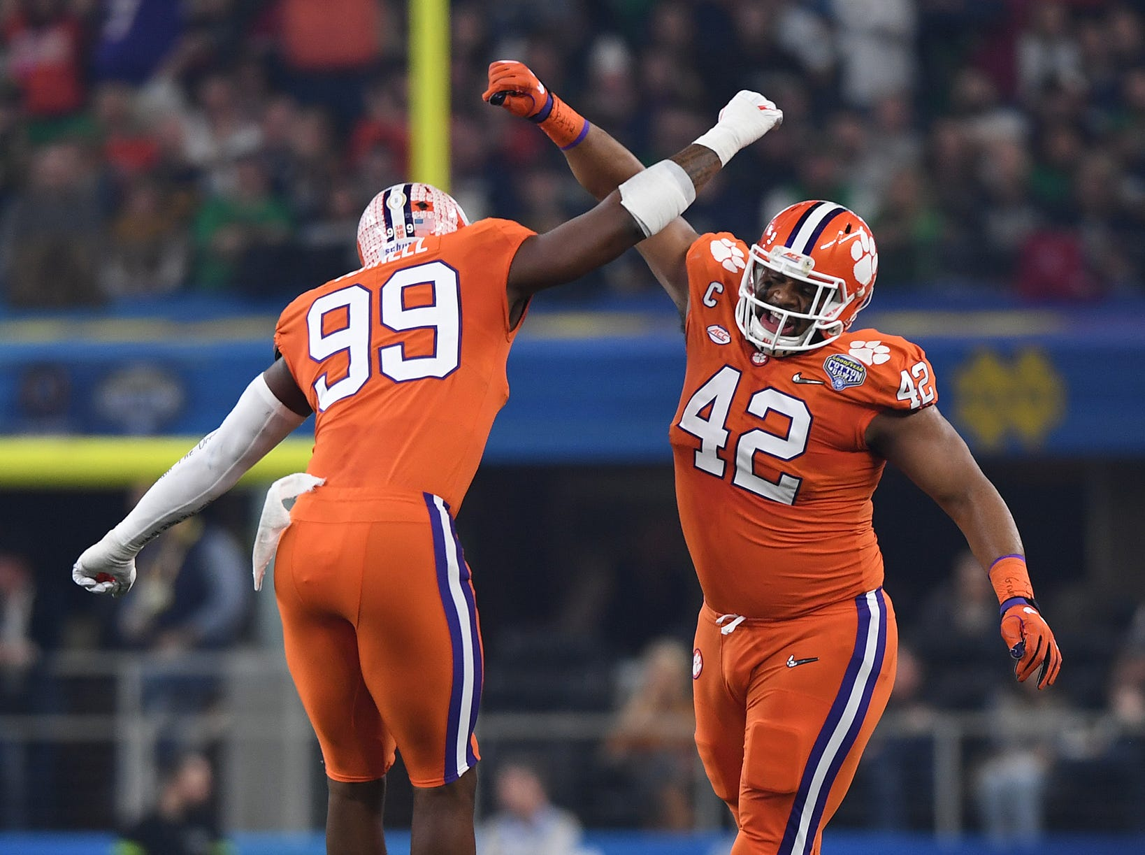 Clemson defensive lineman Clelin Ferrell (99) and defensive lineman Christian Wilkins (42) react after Ferrell recovered a fumble by Notre Dame quarterback Ian Book (12) during the 1st quarter of the Goodyear Cotton Bowl at AT&T stadium in Arlington, TX Saturday, December 29, 2018.