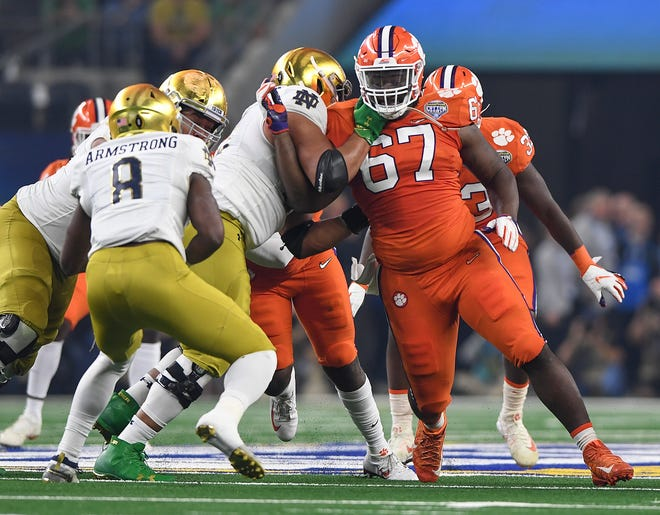 Clemson defensive lineman Albert Huggins (67) plays against Notre Dame during the 1st quarter of the Goodyear Cotton Bowl at AT&T stadium in Arlington, TX Saturday, December 29, 2018.