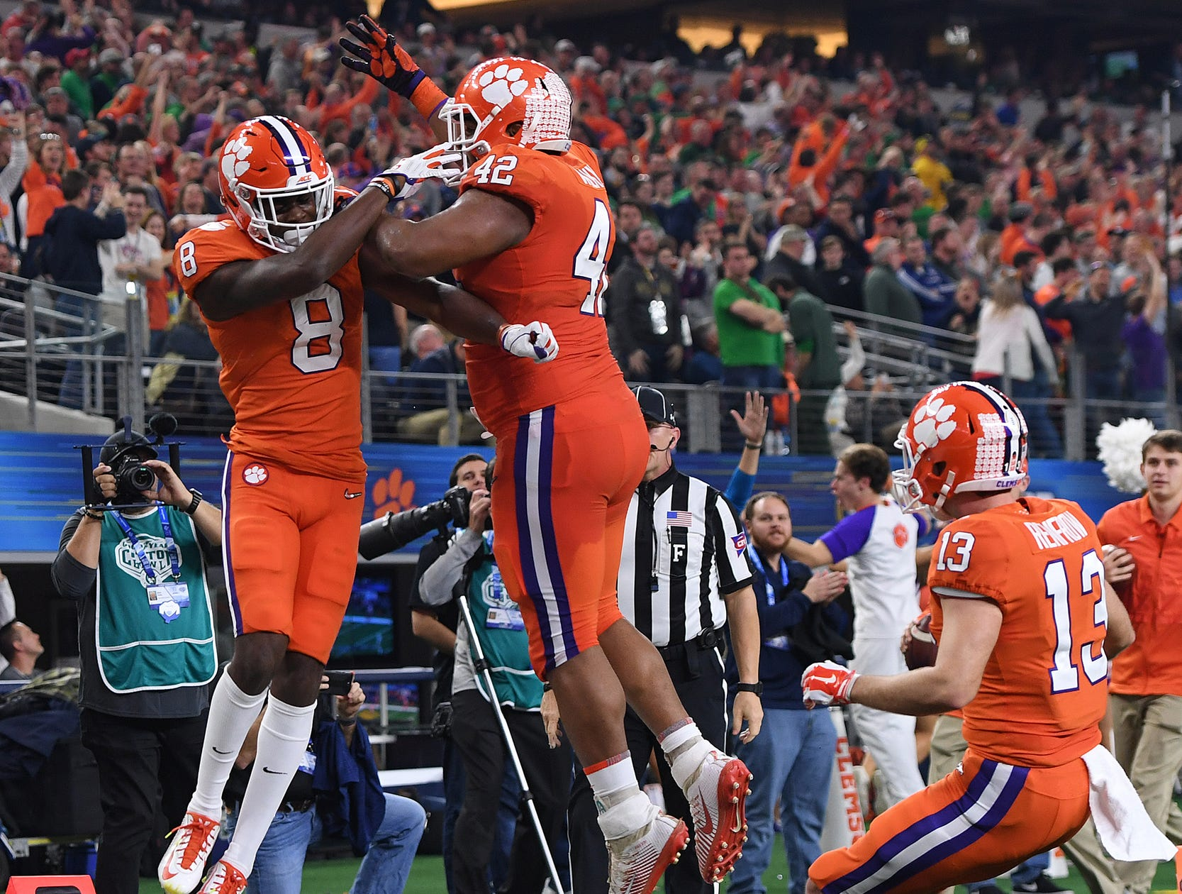 Clemson defensive lineman Christian Wilkins (42) celebrates with wide receiver Justyn Ross (8) after Ross caught a 42 yard TD against Notre Dame during the 2nd quarter of the Goodyear Cotton Bowl at AT&T stadium in Arlington, TX Saturday, December 29, 2018.
