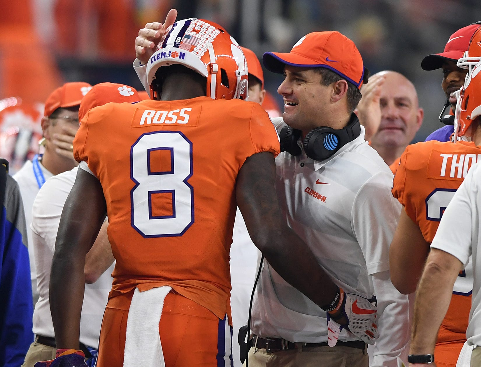 Clemson wide receiver Justyn Ross (8) is congratulated by co-offensive coordinator Jeff Scott after scoring against Notre Dame on a 52 yard reception during the 2nd quarter of the Goodyear Cotton Bowl at AT&T stadium in Arlington, TX Saturday, December 29, 2018.