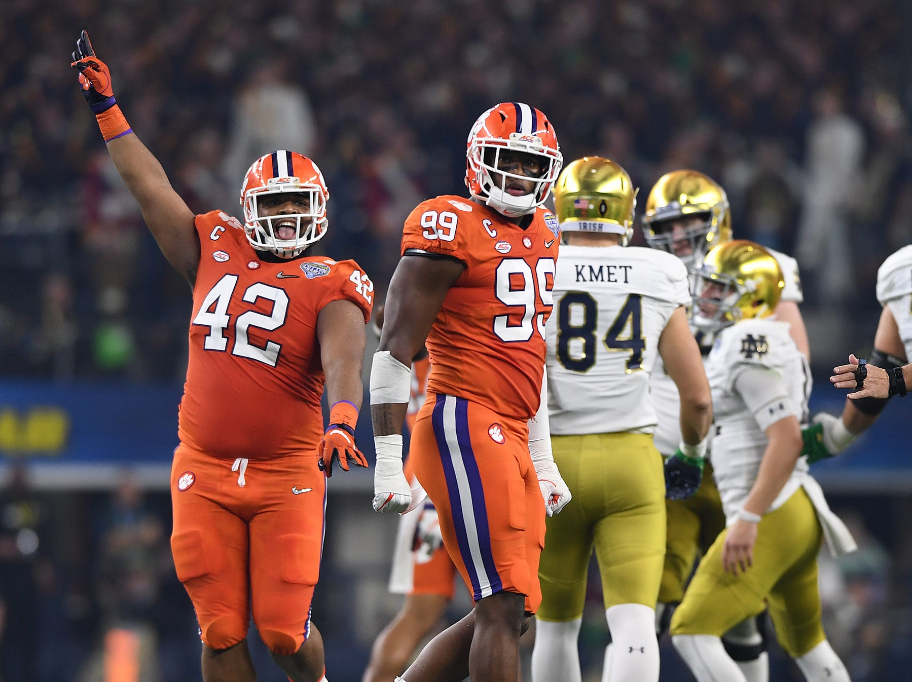Clemson defensive lineman Christian Wilkins (42) celebrates after a defensive stop by defensive lineman Clelin Ferrell (99) during the 1st quarter of the Goodyear Cotton Bowl at AT&T stadium in Arlington, TX Saturday, December 29, 2018.