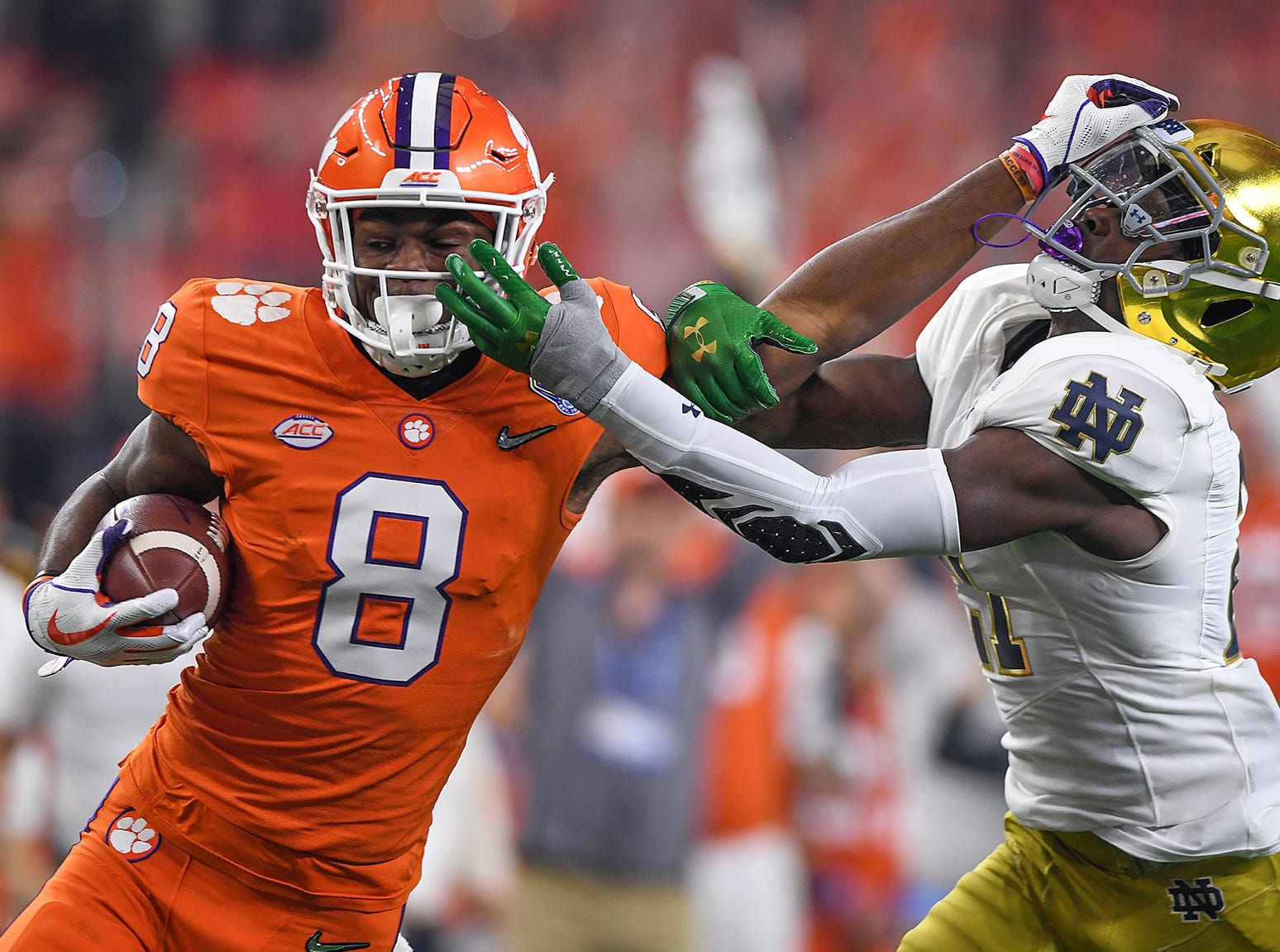 Clemson wide receiver Justyn Ross (8) stiff arms Notre Dame safety Alohi Gilman (11) on the way to scoring on a 52 yard reception during the 2nd quarter of the Goodyear Cotton Bowl at AT&T stadium in Arlington, TX Saturday, December 29, 2018.