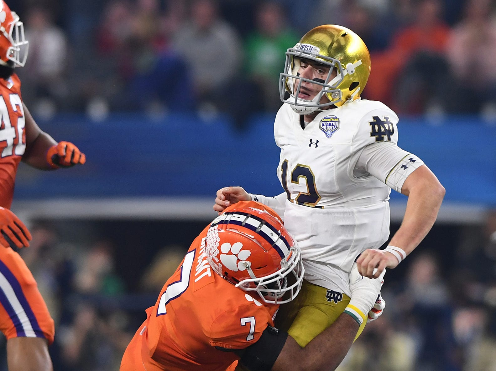 Clemson defensive lineman Austin Bryant (7) hits Notre Dame quarterback Ian Book (12) during the 2nd quarter of the Goodyear Cotton Bowl at AT&T stadium in Arlington, TX Saturday, December 29, 2018.