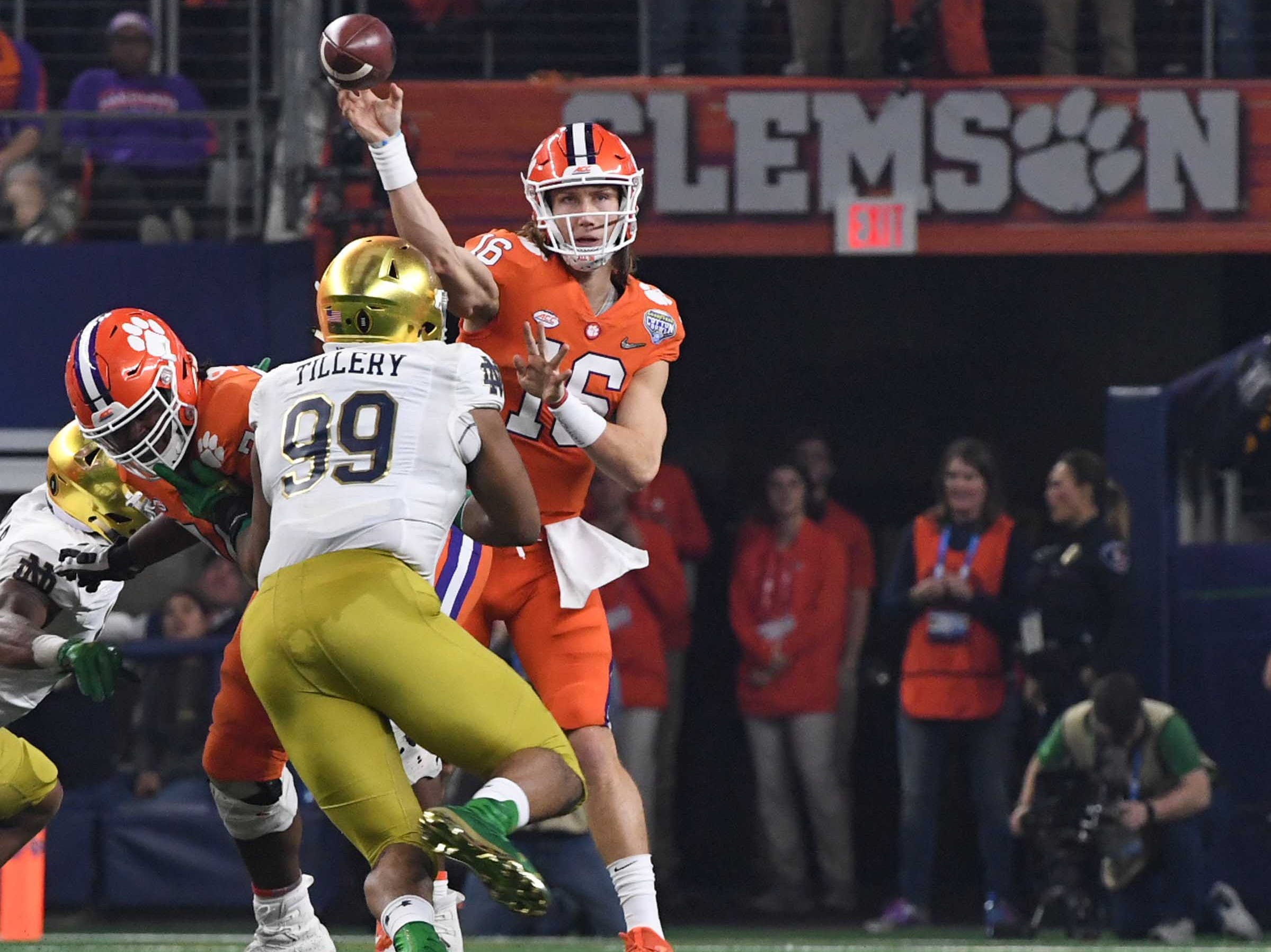 Clemson quarterback Trevor Lawrence (16) throws the first of two touchdowns to wide receiver Justyn Ross (8) during the second quarter of the College Football Playoff Semifinal at the Goodyear Cotton Bowl Classic at AT&T Stadium in Arlington, Texas Saturday, December 29, 2018.